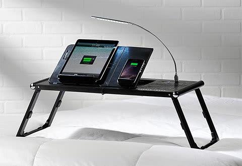 For men who like gadgets. Laptop charger desk by Sharper Image.