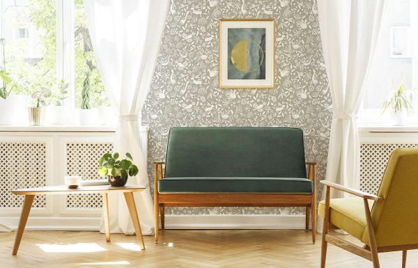 Mid-century living room interior with coffee table, blue sofa, blue painting with gold