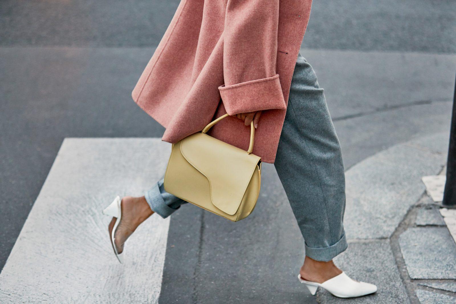 Pink coat and cream handbag from paris fashion week