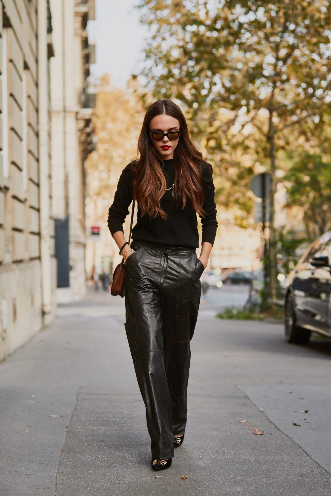 Slim black blouse with shiny charcoal pants