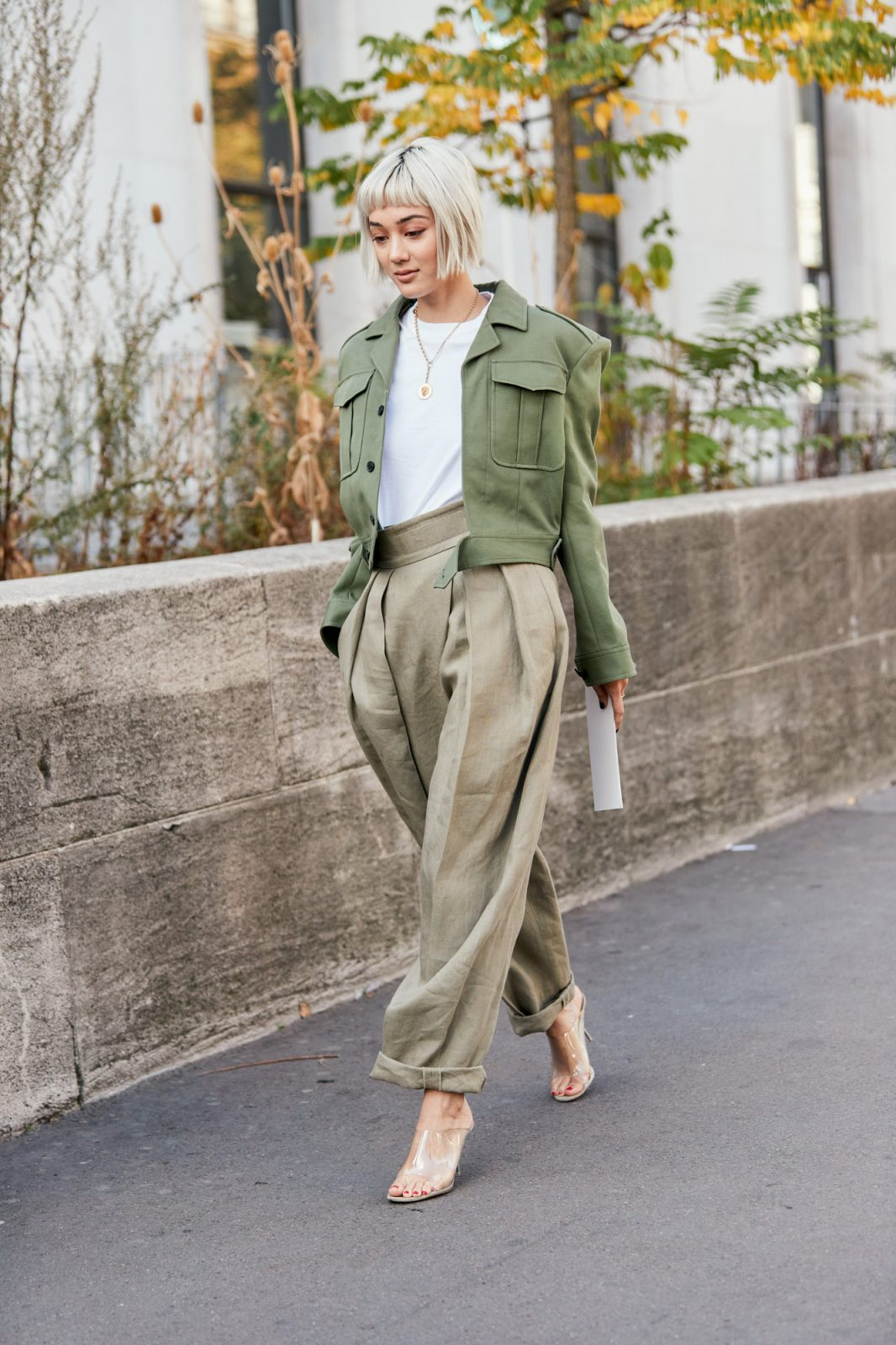 Green coat with rolled pleated pants