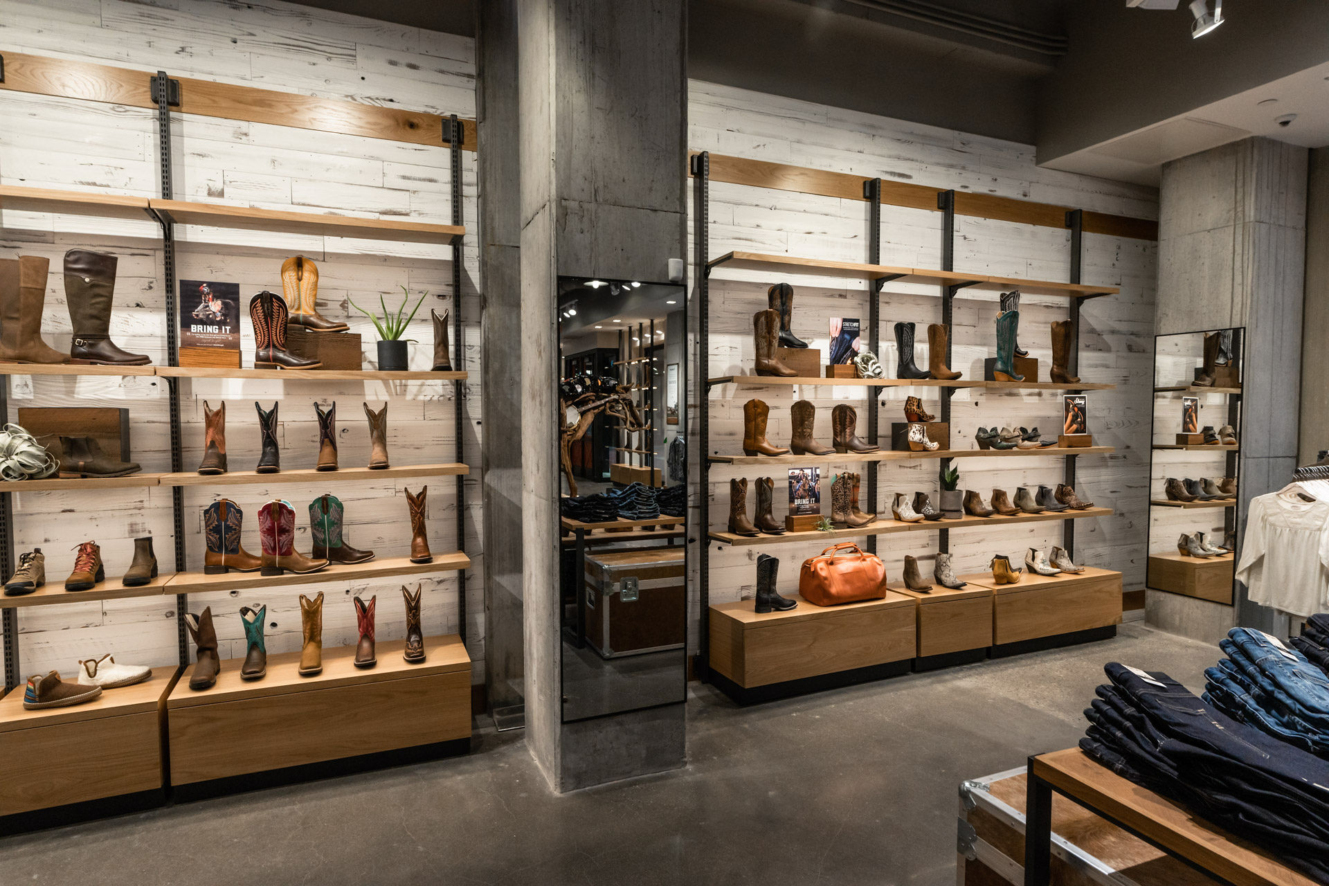 ariat store boot wall and jeans
