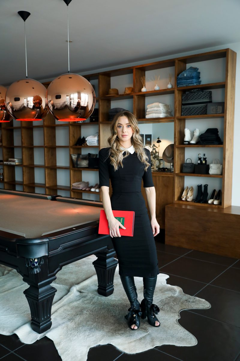 Owning the billiard room in a black statement dress
