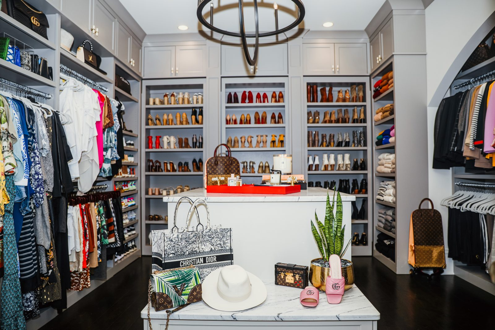 Elizabeth's closet, dresses on the left, tops on the right, shoes to the back