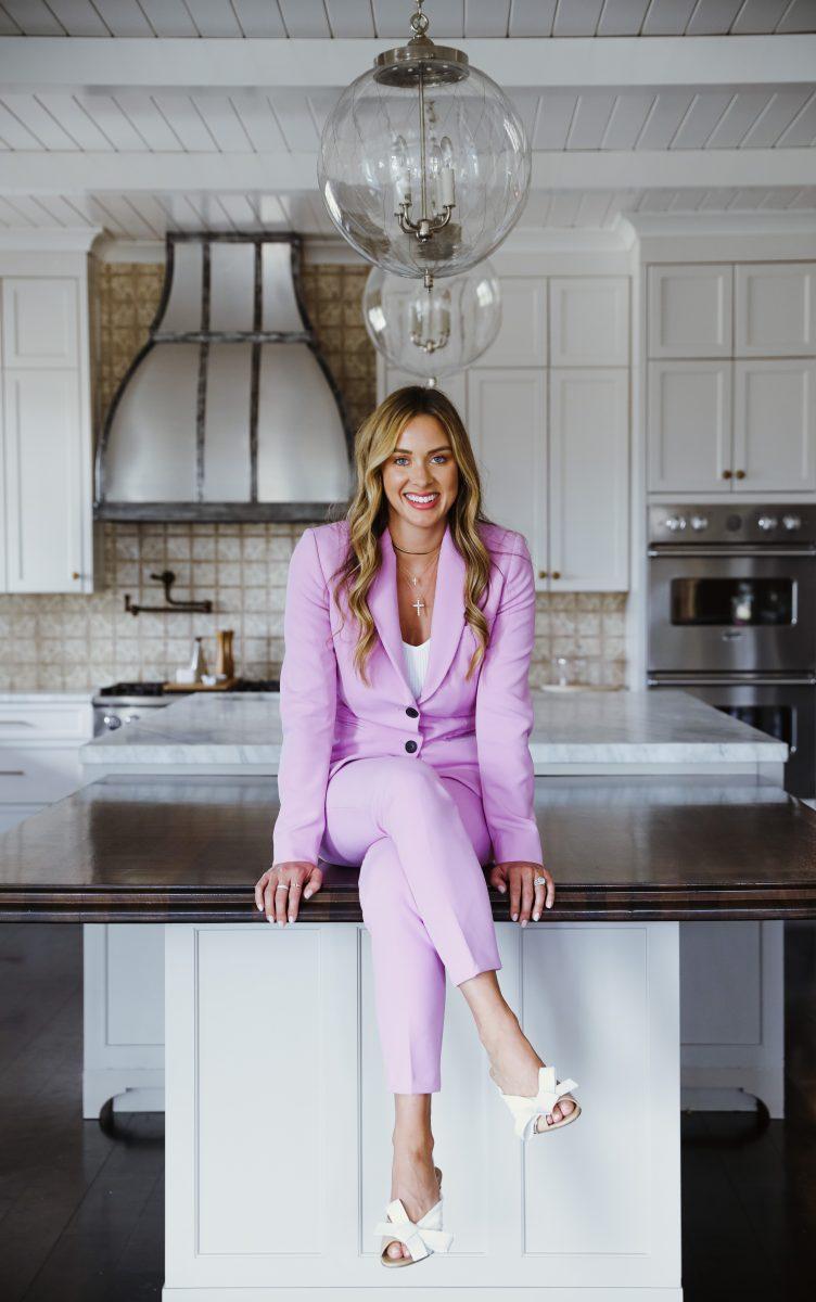 Elizabeth Allen sitting in the kitchen in her pink power suit.