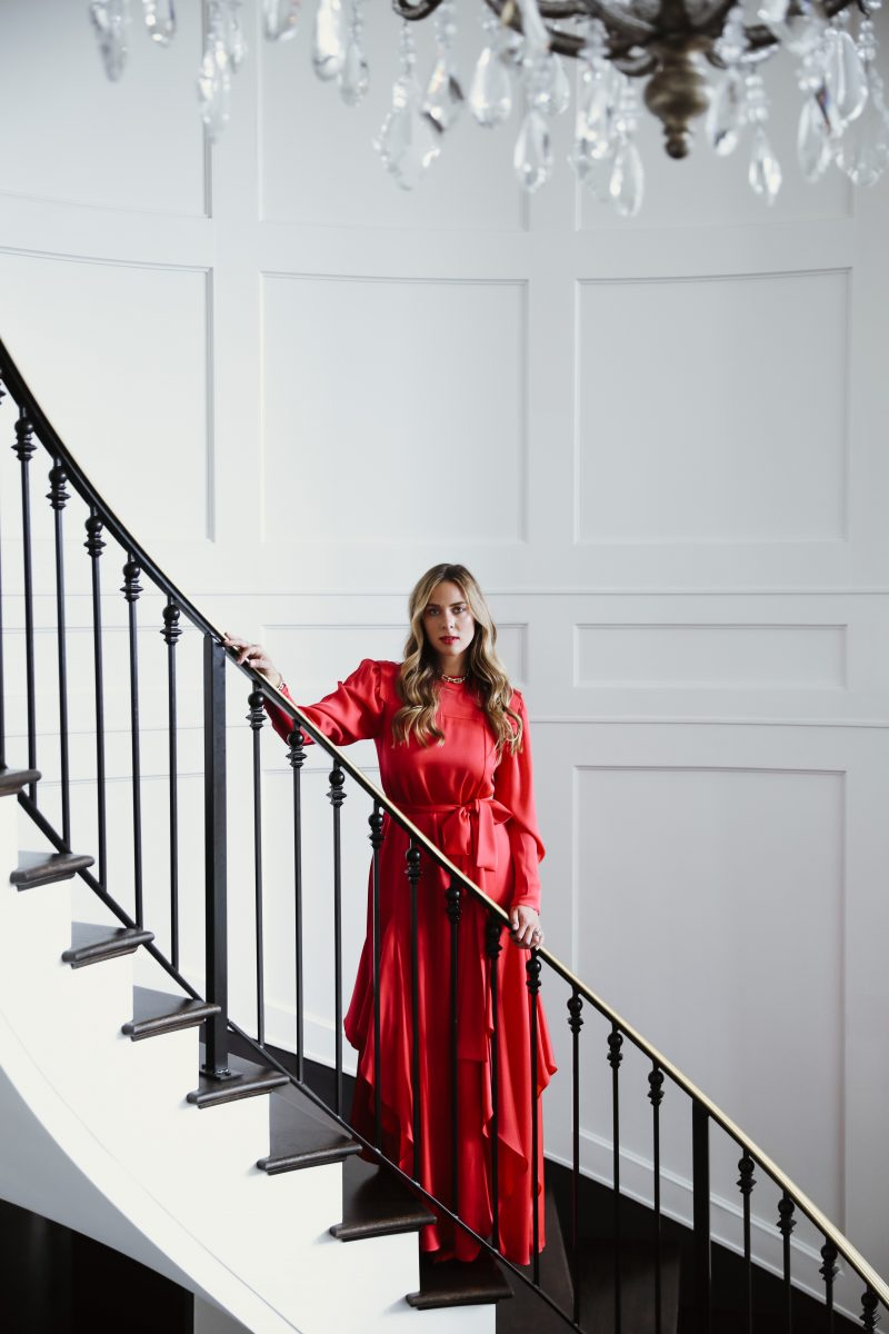 Vertical aspect ratio red dress staircase photo from Elizabeth Allen photoshoot