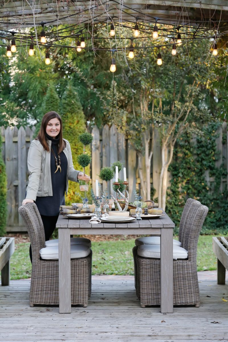 Upgrade your outdoor dining space with hanging lights and potted plants