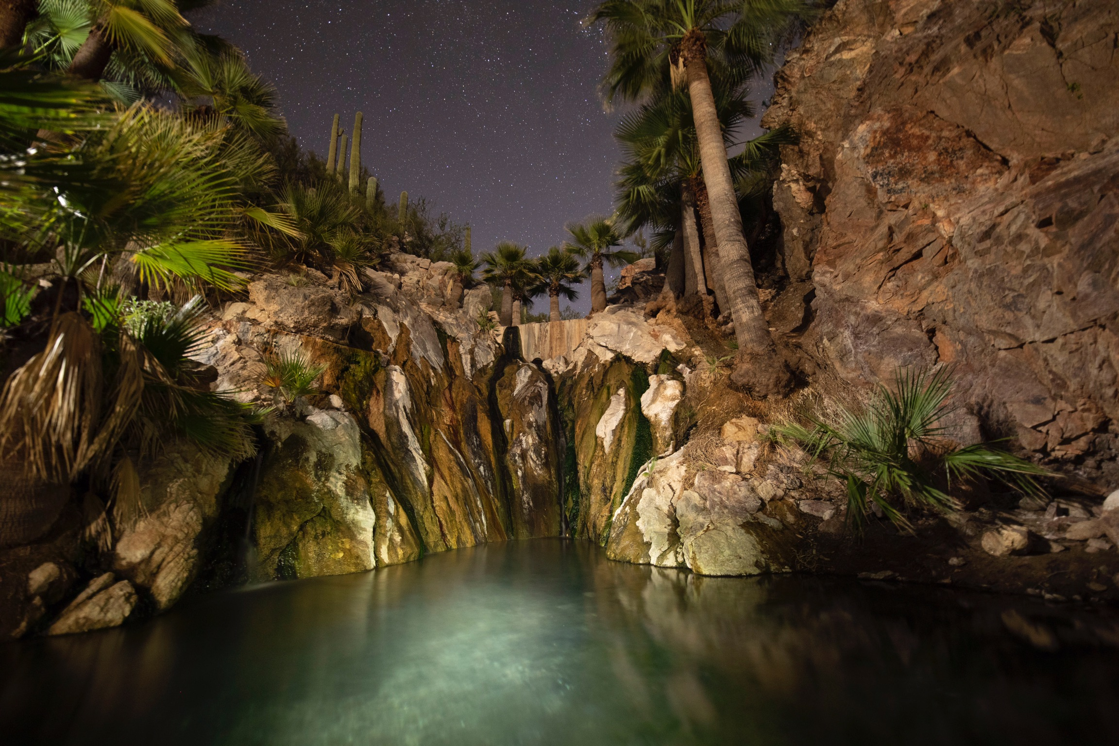 Night at Castle Hot Springs, photographed by Robert Pflumm. Lit hot springs so you can relax day and night.