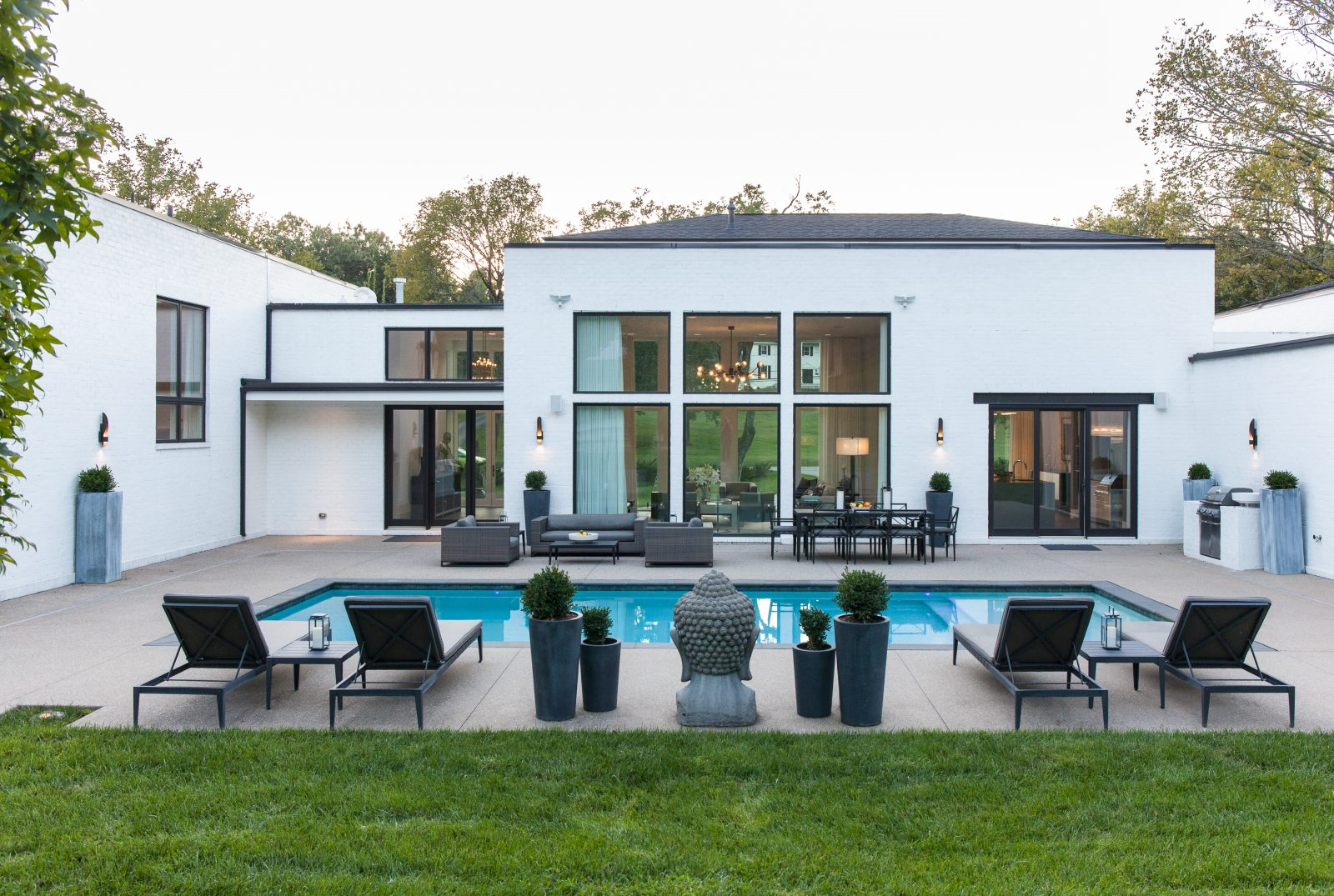 Pool outside of a luxury home with tall windows
