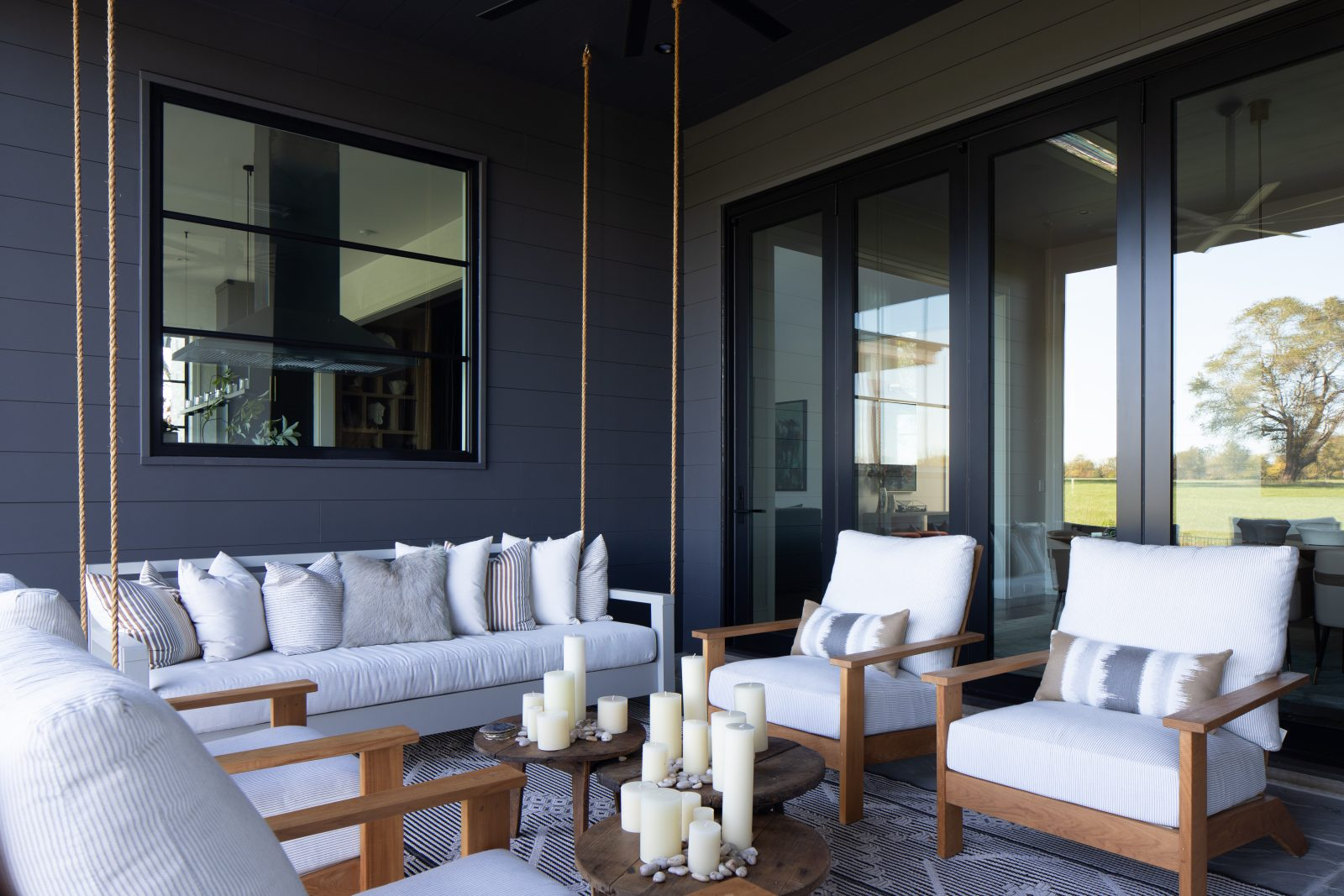 White cushioned outdoor furniture and hanging couch