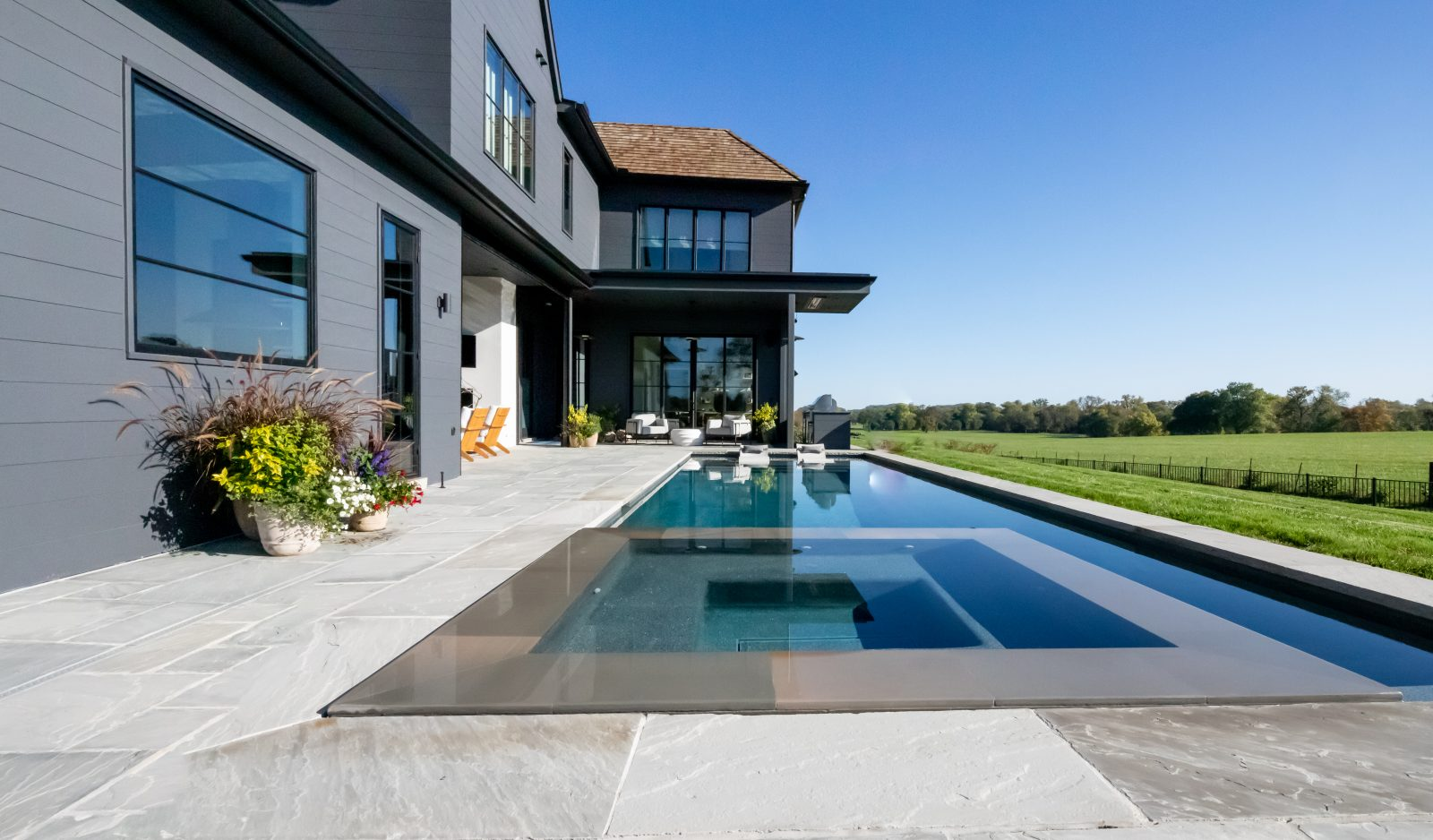 Infinity pool and hot tub with slate deck