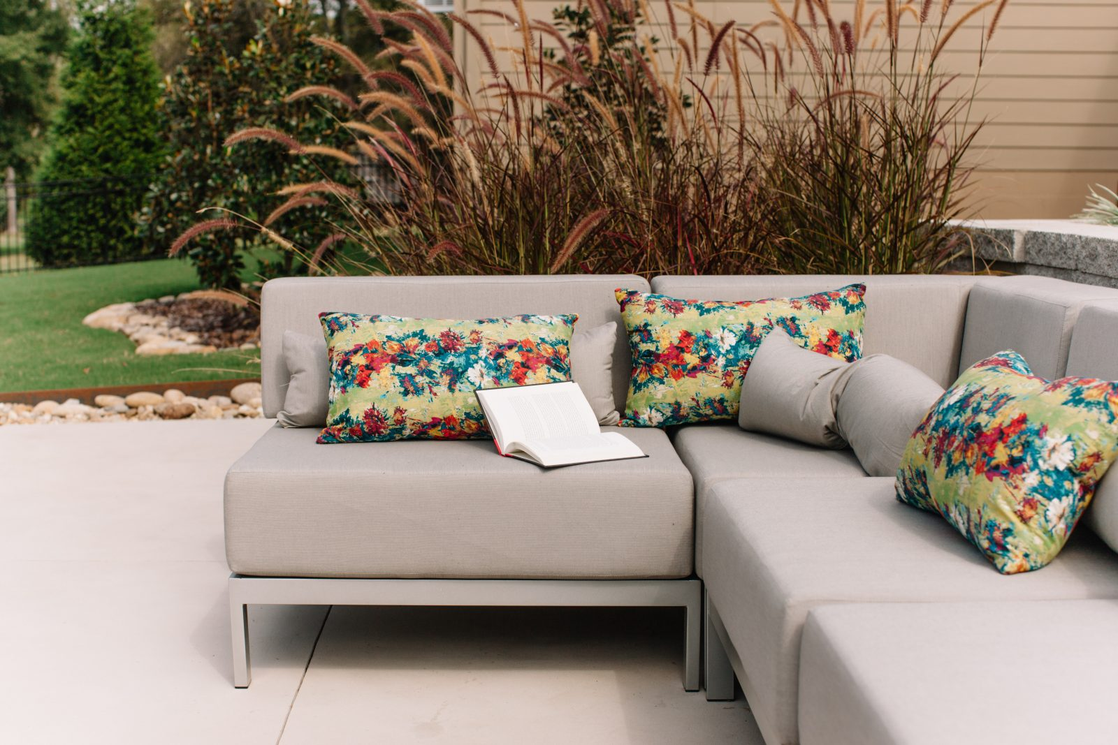 Sectional grey couch with floral pillows