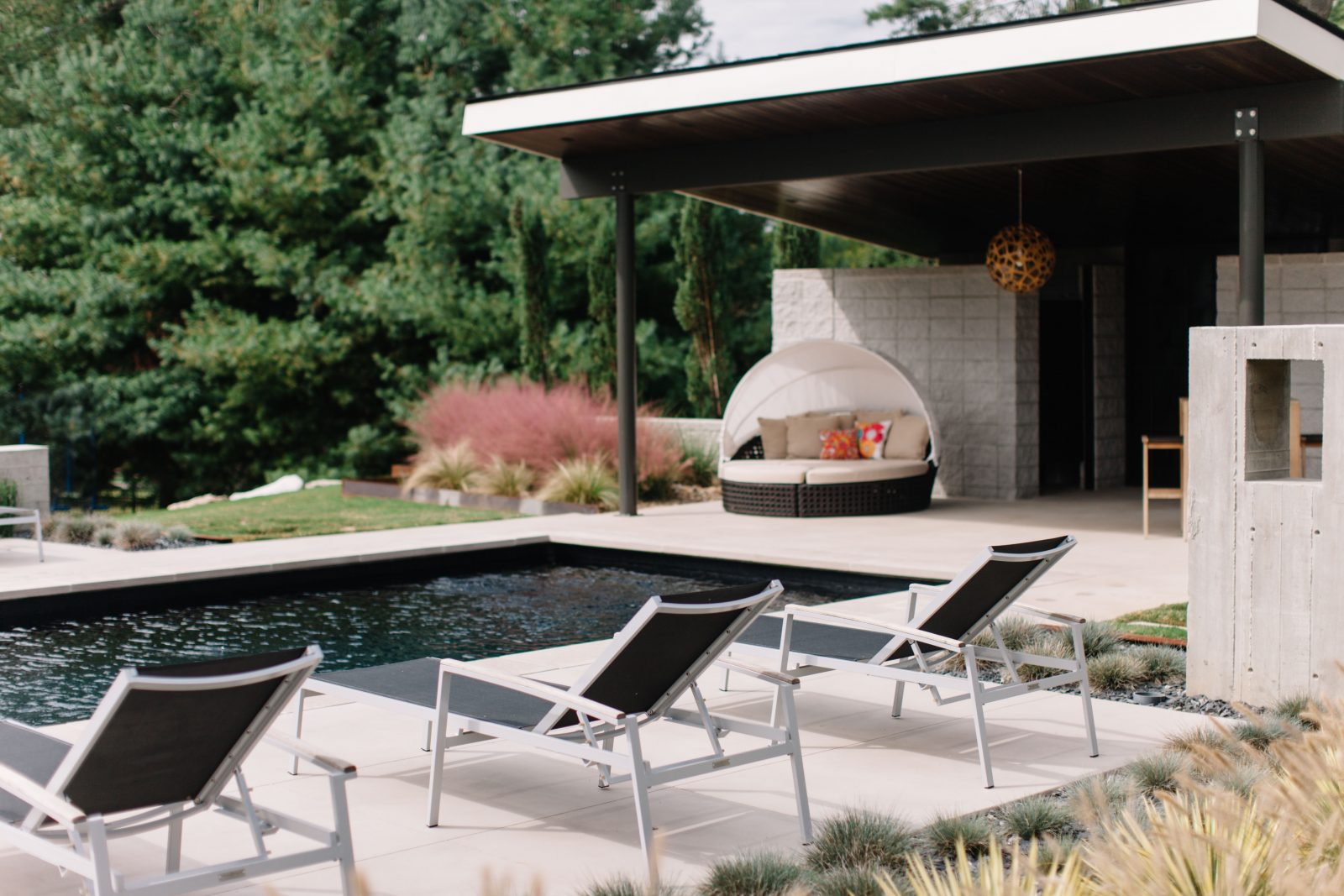 Outdoor pool sitting area and cabana space