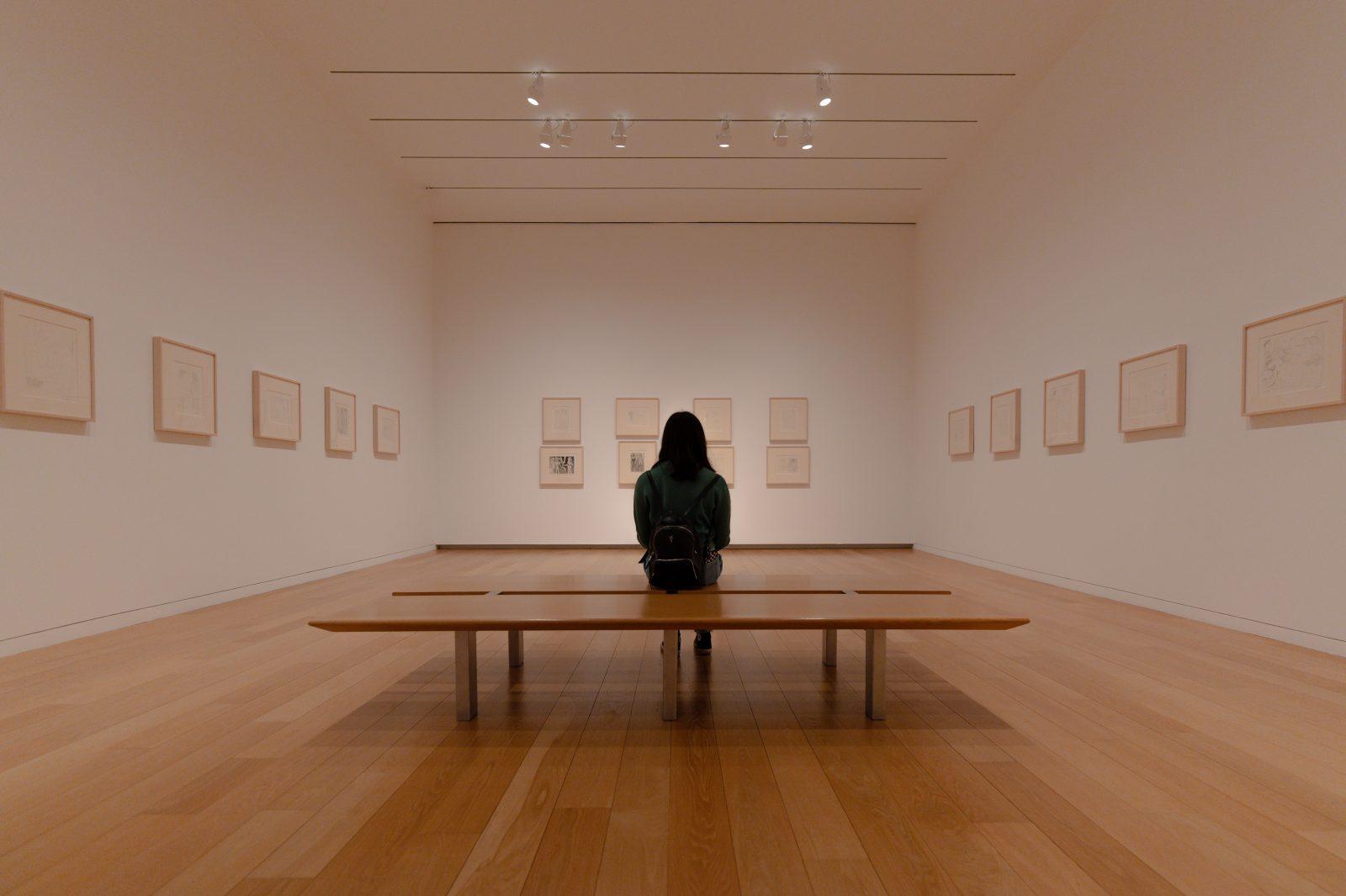 Harding Art Show: Woman sitting in an art gallery
