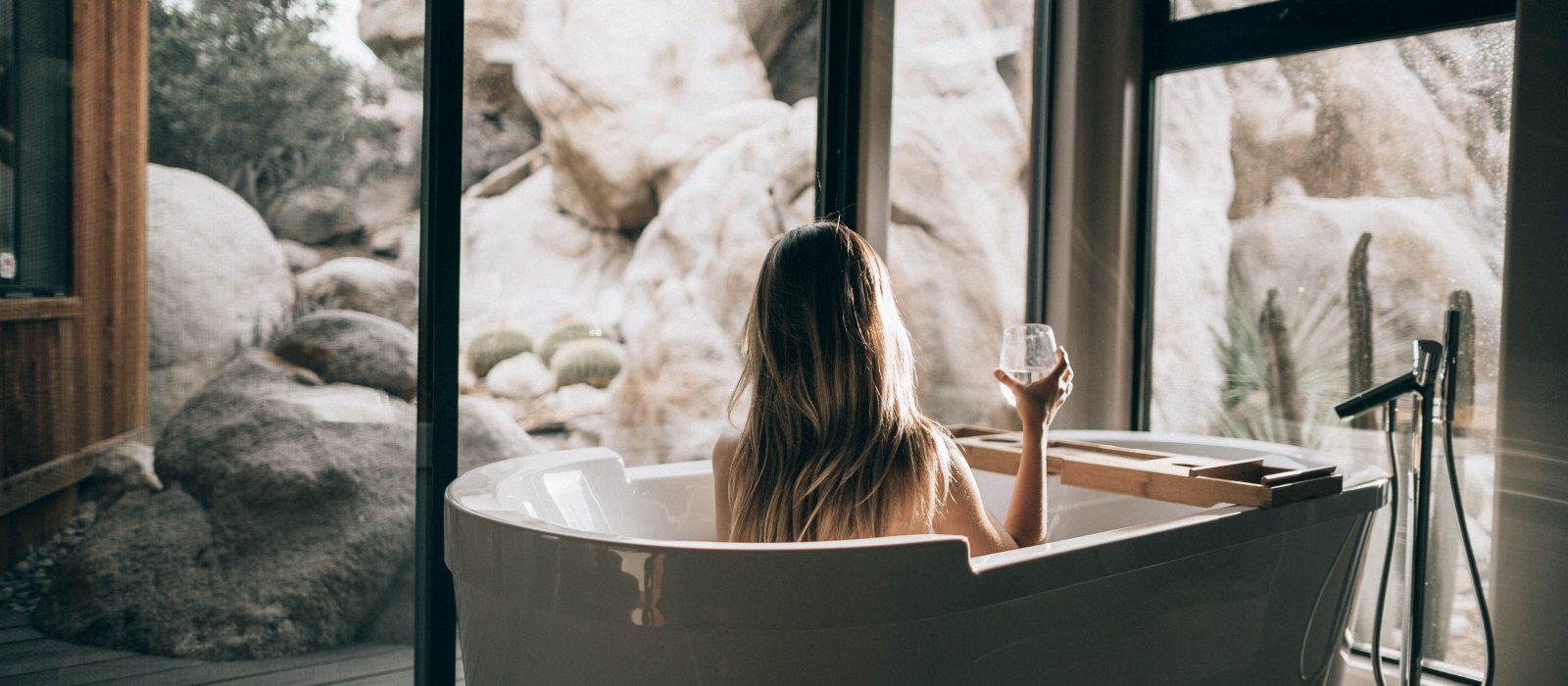 Lemon Laine Owner spa tub and white wine