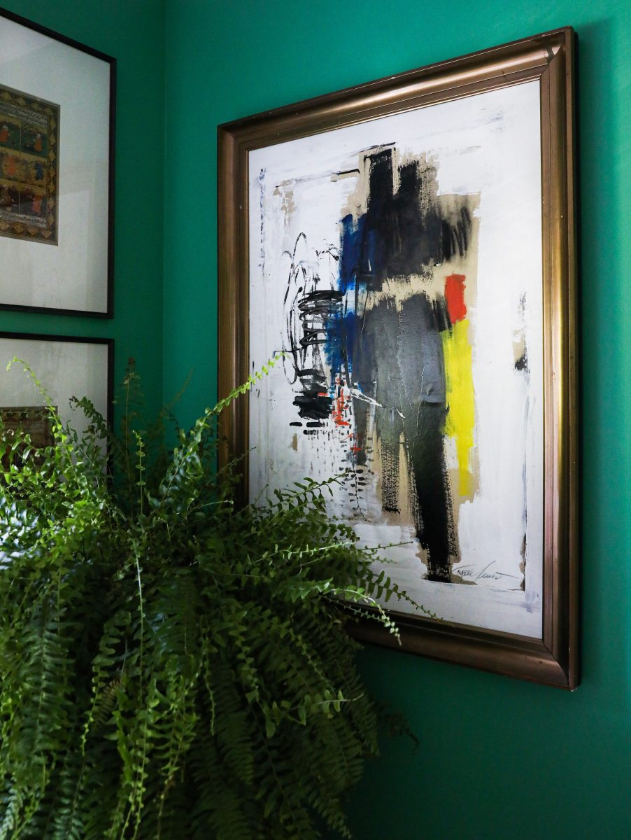 Abstract art on green wall