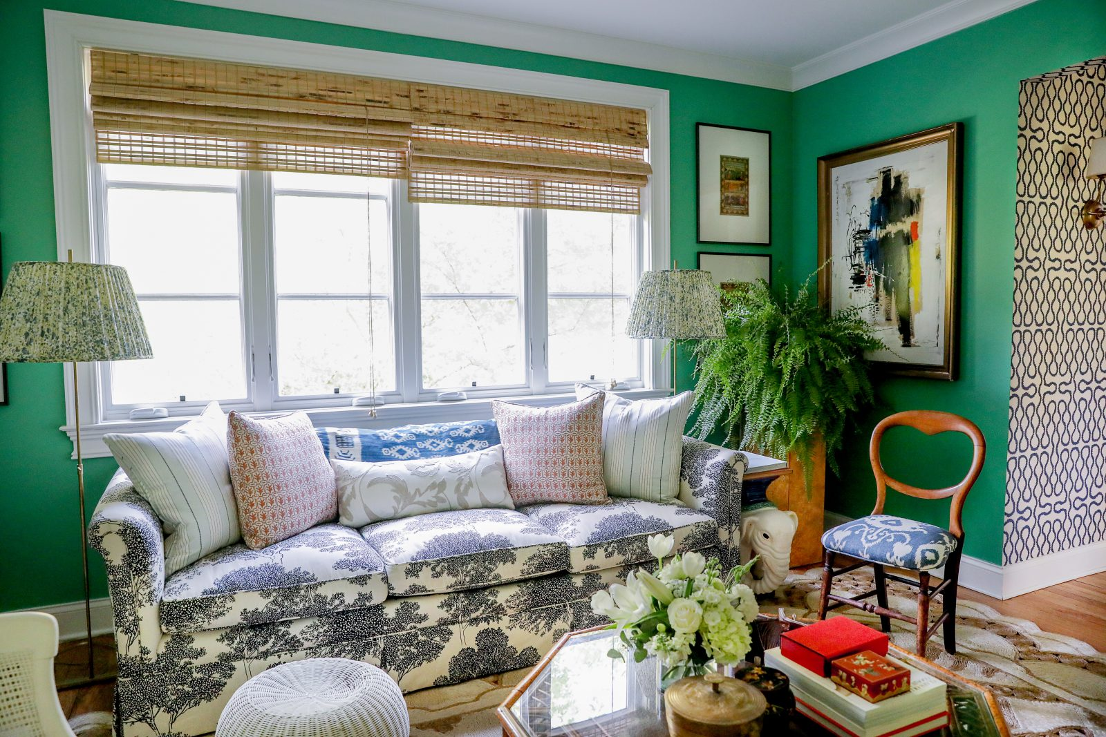 Green living room with blue and white accents and aesthetics