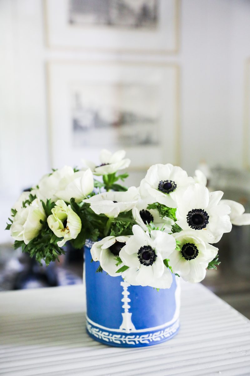 White poppies in a blue and white ceramic jar