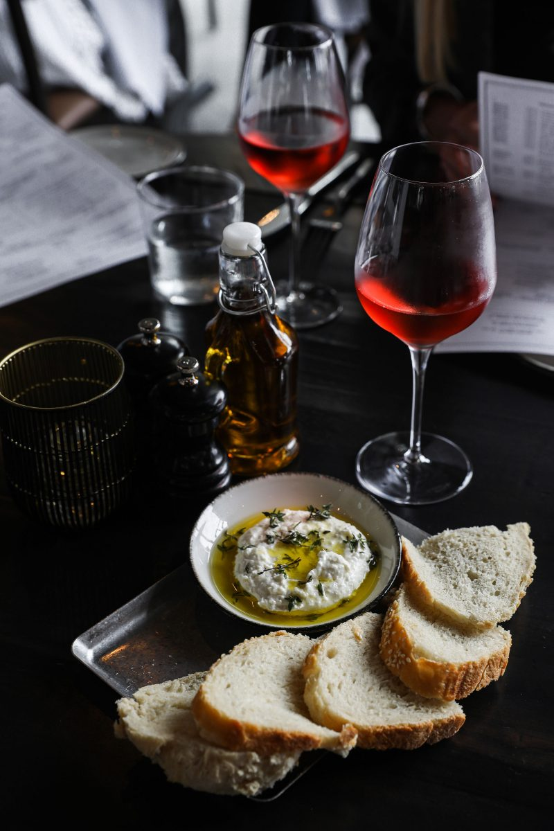 Soft cheese dip, italian bread, olive oil, and red wine