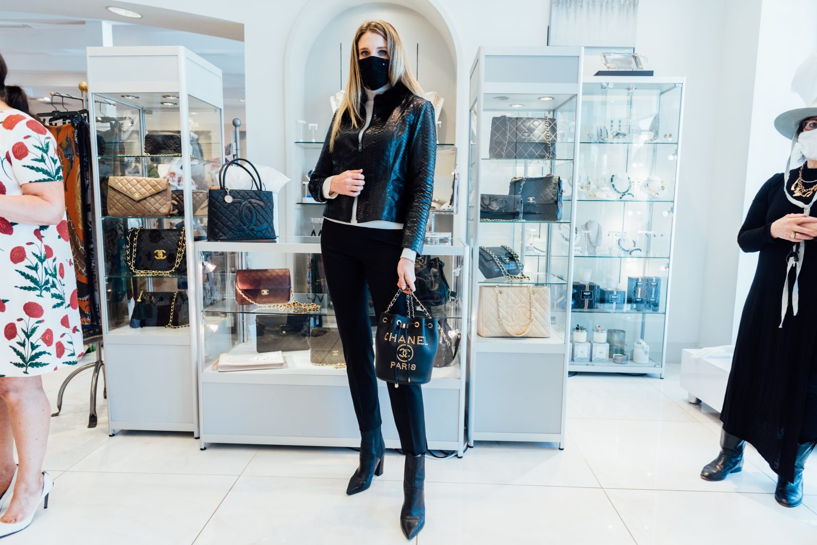 Tall woman showing off her vintage Chanel showcase