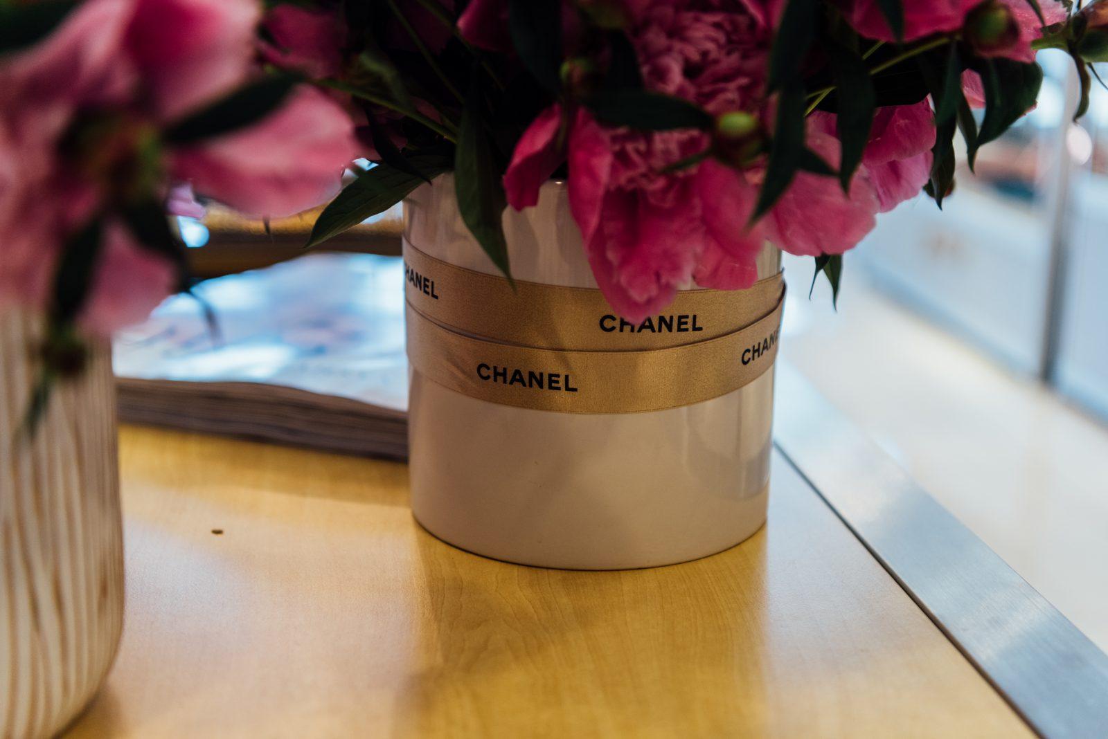 Chanel branding ribbons around flower vases at Gus Mayer