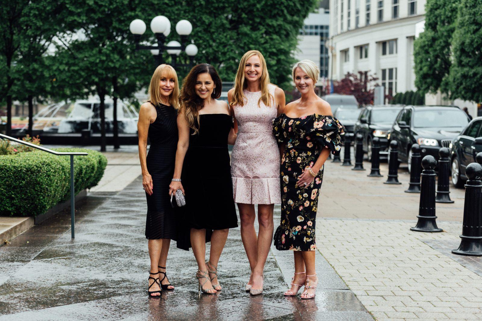 Stacey Rhodes wearing Stacey Rhodes Boutique; Vivian Lavin Fernandez in Zang Toi; Danielle Breezy in Lily Pulitzer; Emily Humphreys wearing Monique L'Huillier