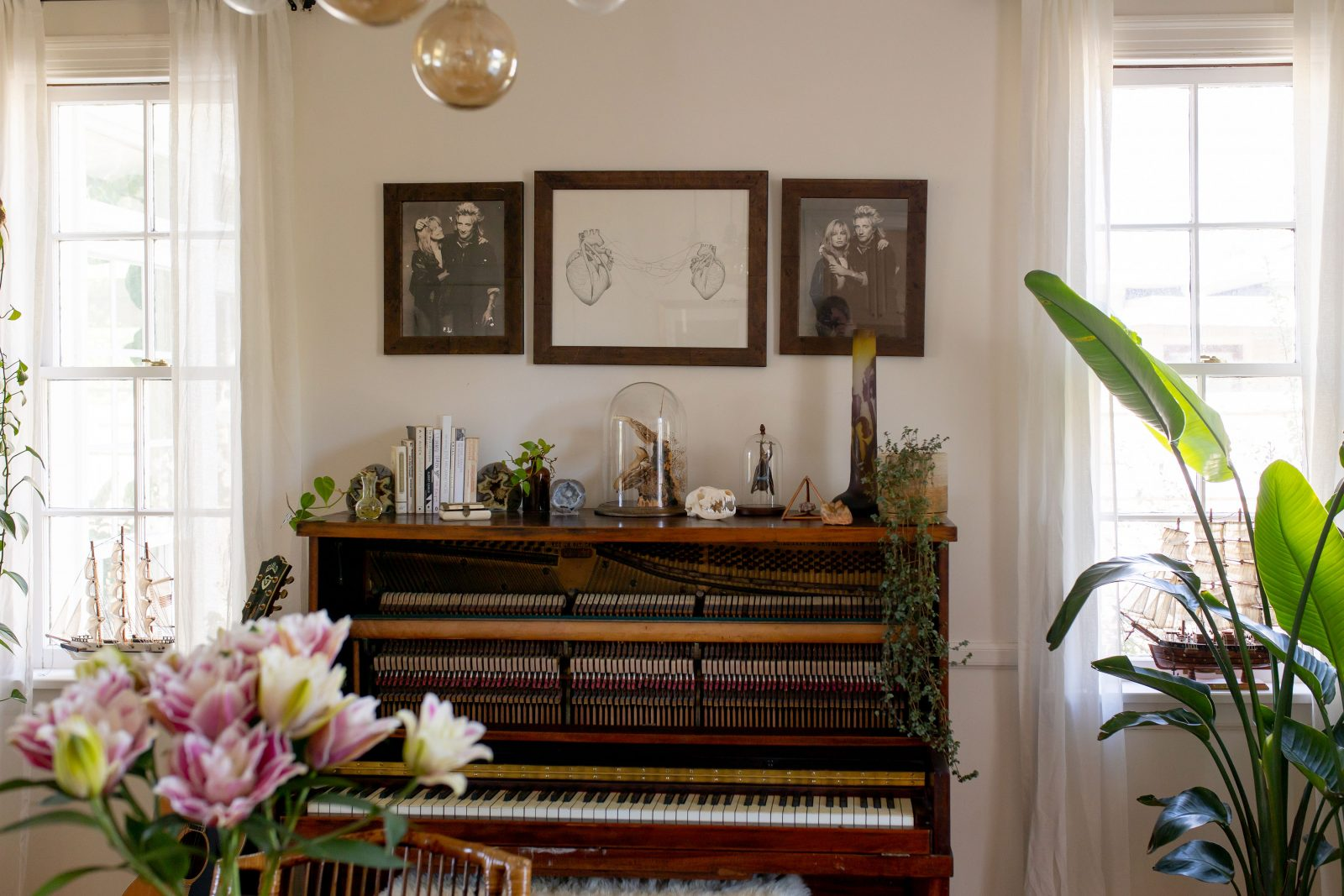 Ruby's piano with family pictures above it