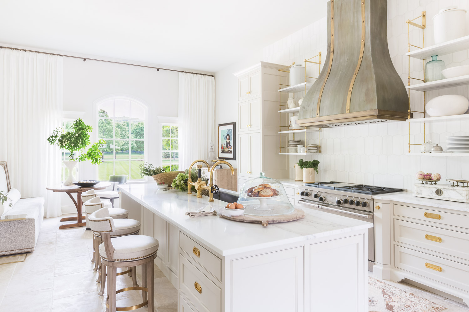 White kitchen space with neutral accent tones and gold metal elements
