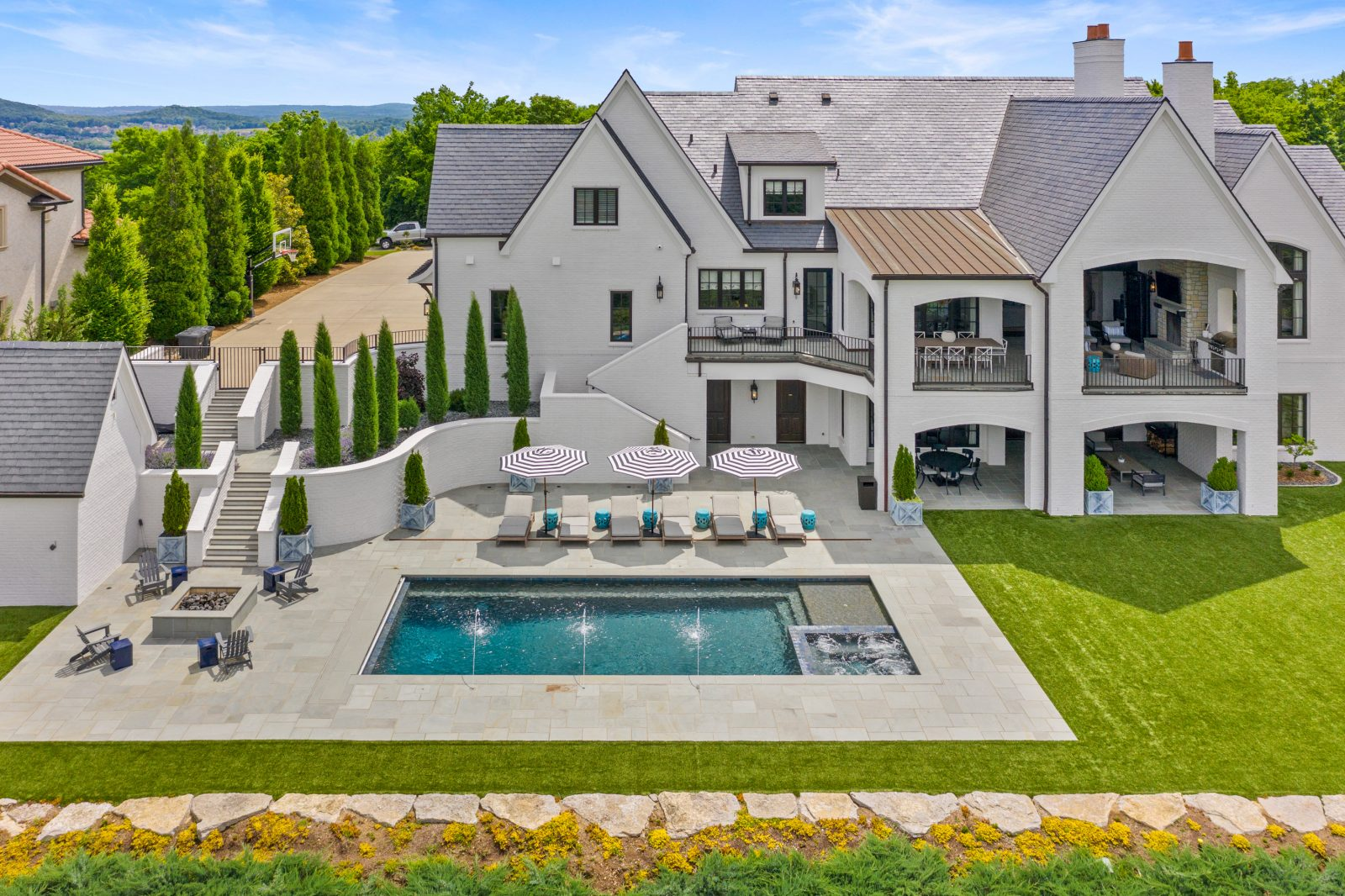 Full backyard, pool, and rear elevation of house in Franklin, TN