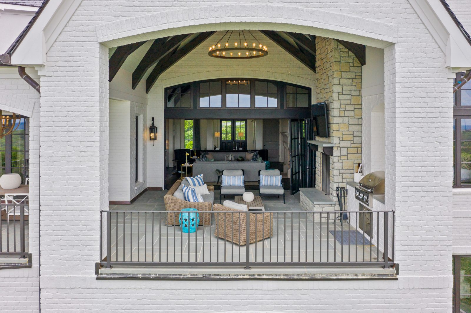 Family lounge area with gates for toddlers and comfortable outdoor furniture