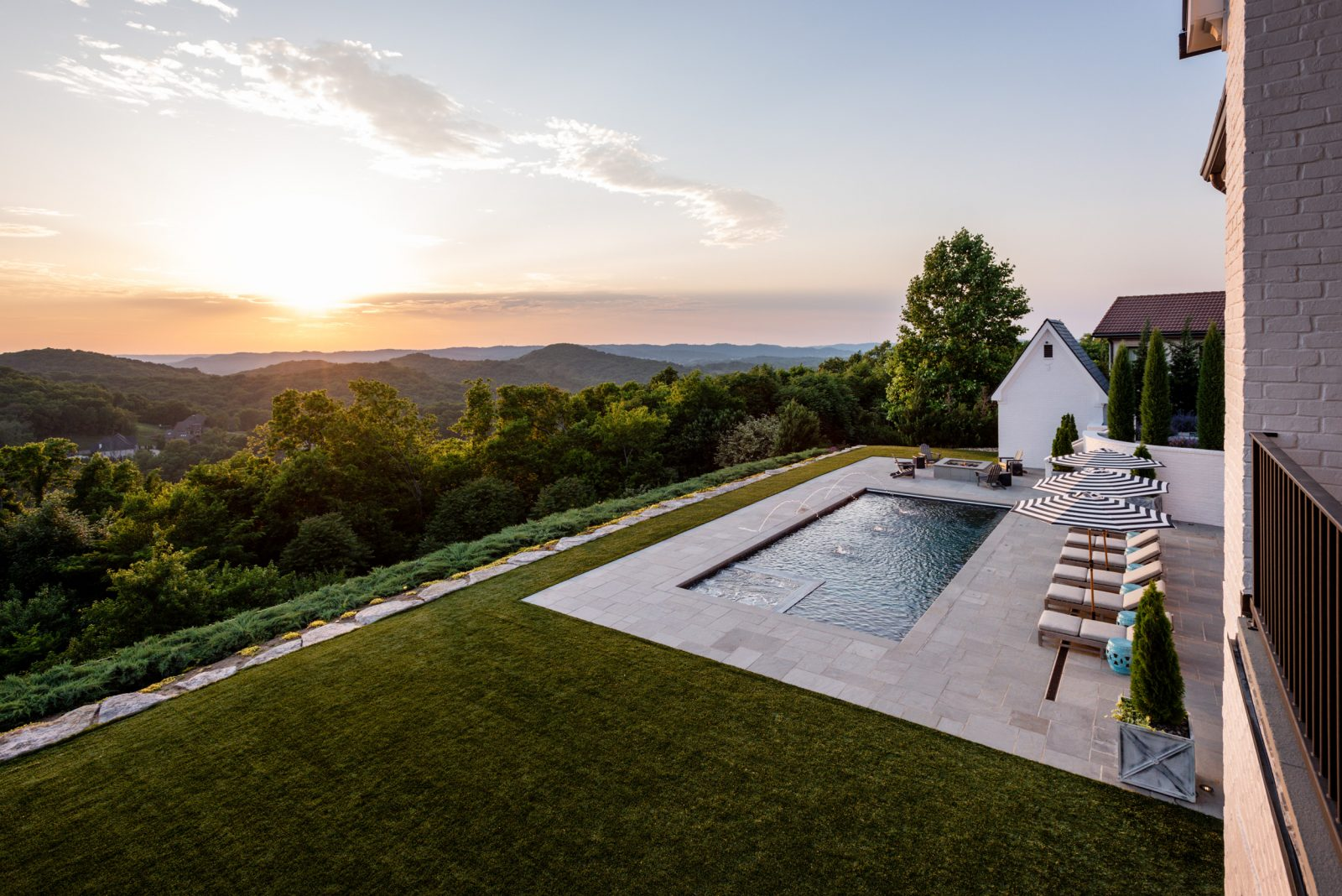 Picture of a pool on a hilltop overlooking the surrounding Franklin, TN area at sunset
