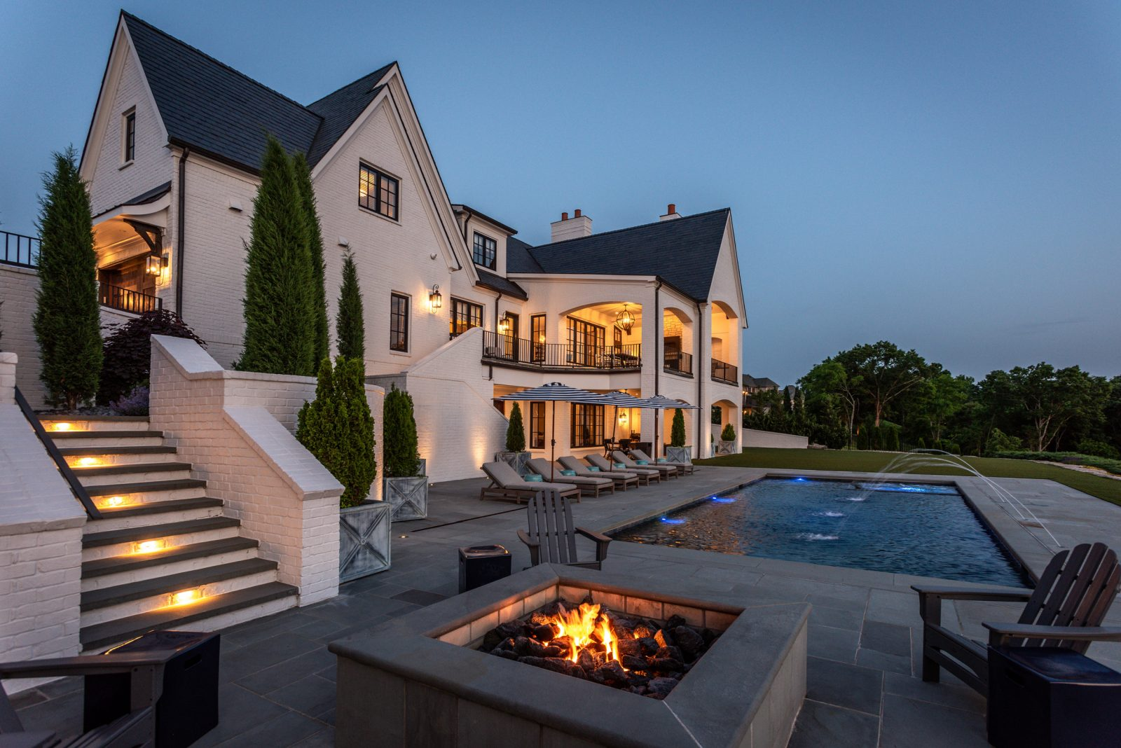 Fire pit and pool at dusk in Franklin, TN