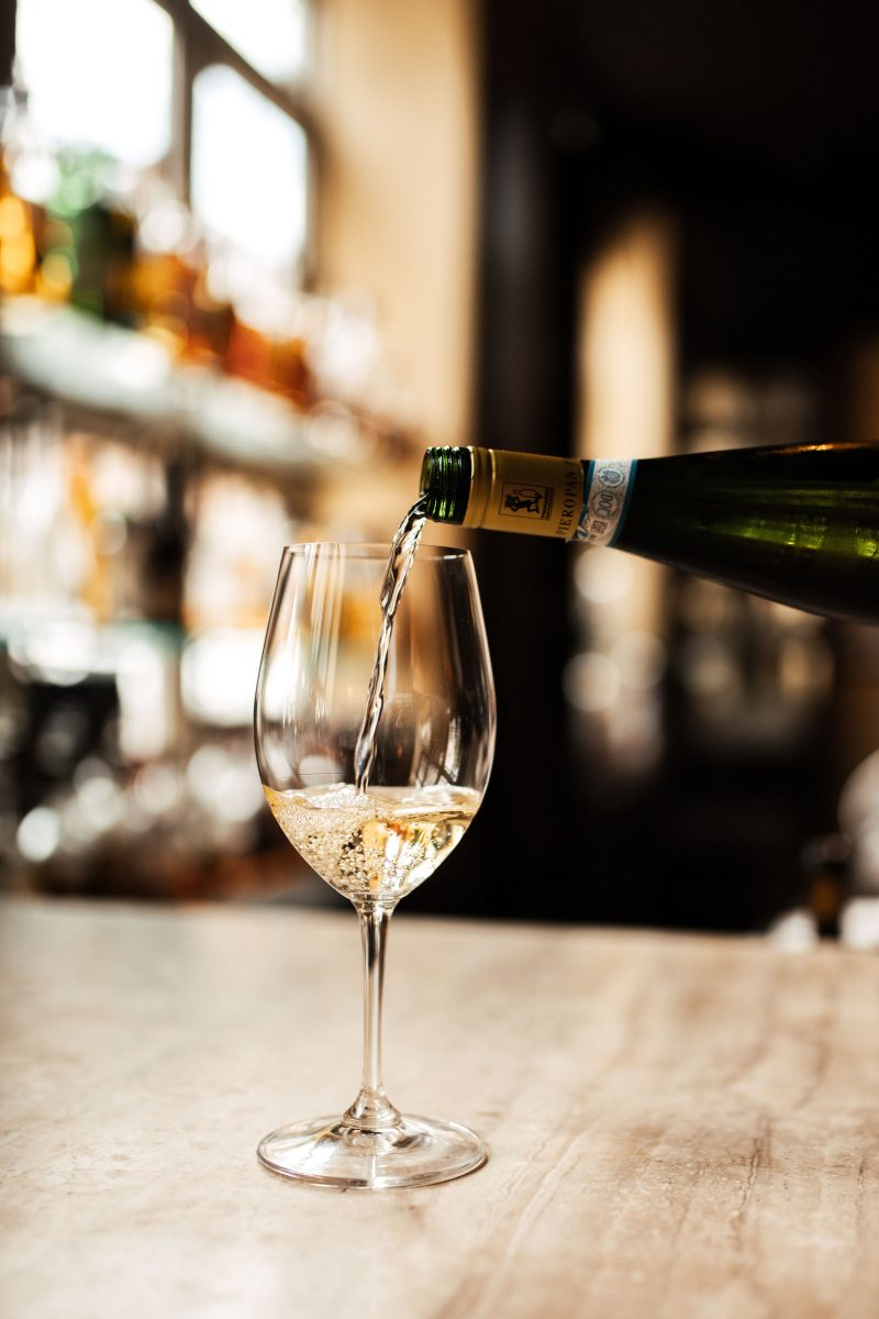 White Wine being poured into a wine glass in Nashville.