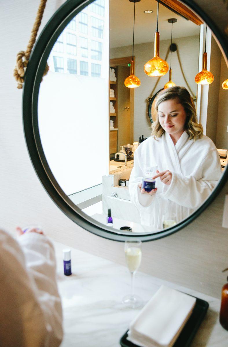 a blonde woman enjoying the Mokara spa, prepping for a facial treatment. Located in Nashville.