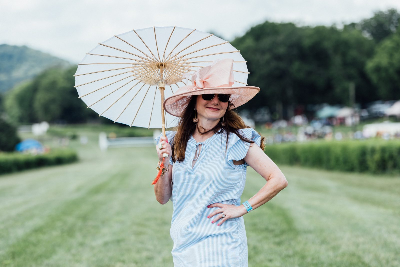 Adrian E Morales at the TN Steeplechase fashion show with The Nashville Edit.