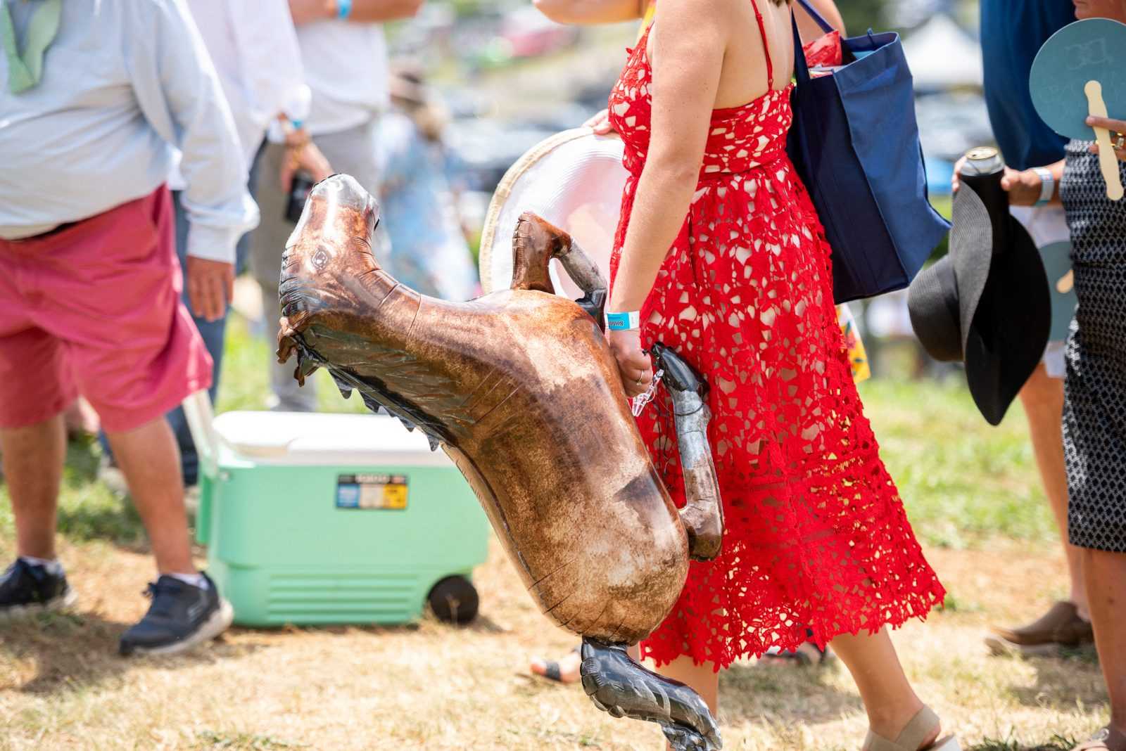 Woman holding a horse balloon from Steeplechase 21