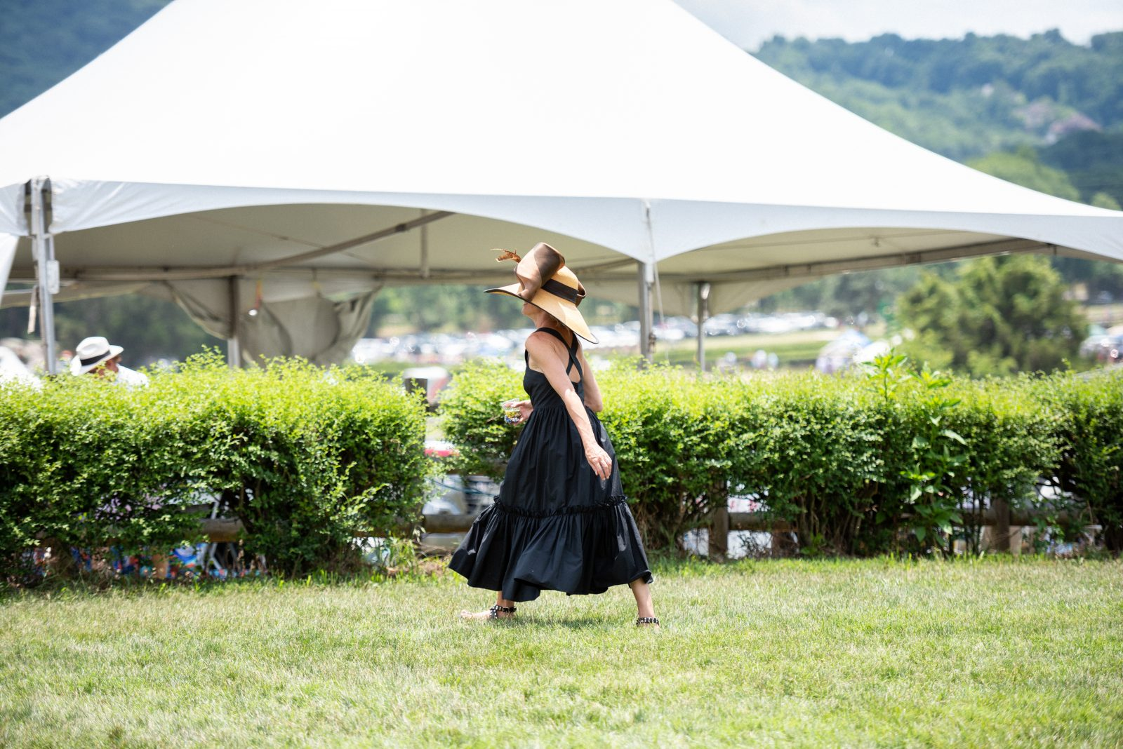 Woman in black summer dress at steeplechase 21