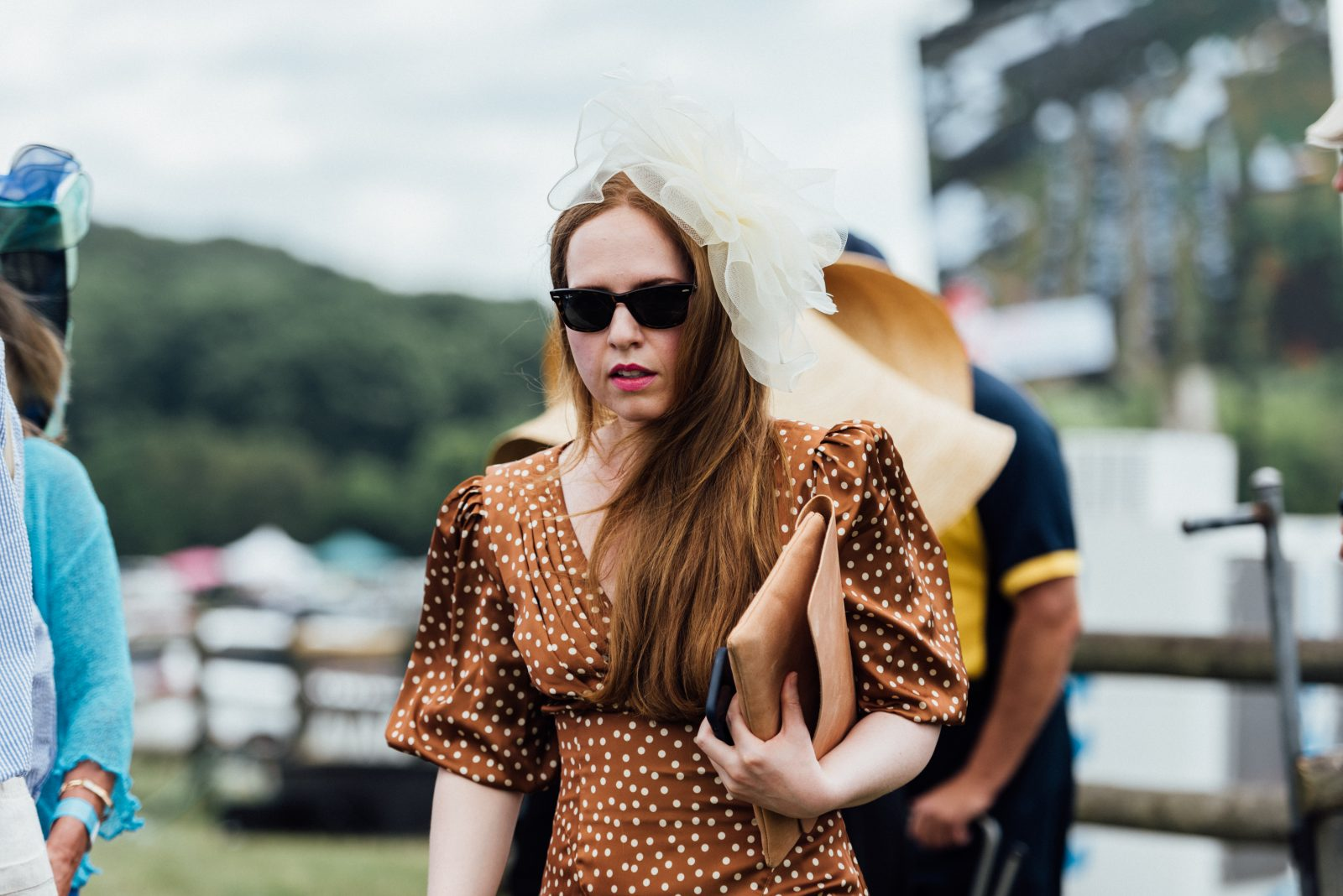 Women in bronze dress with white polka dots at TN Steeplechase 21