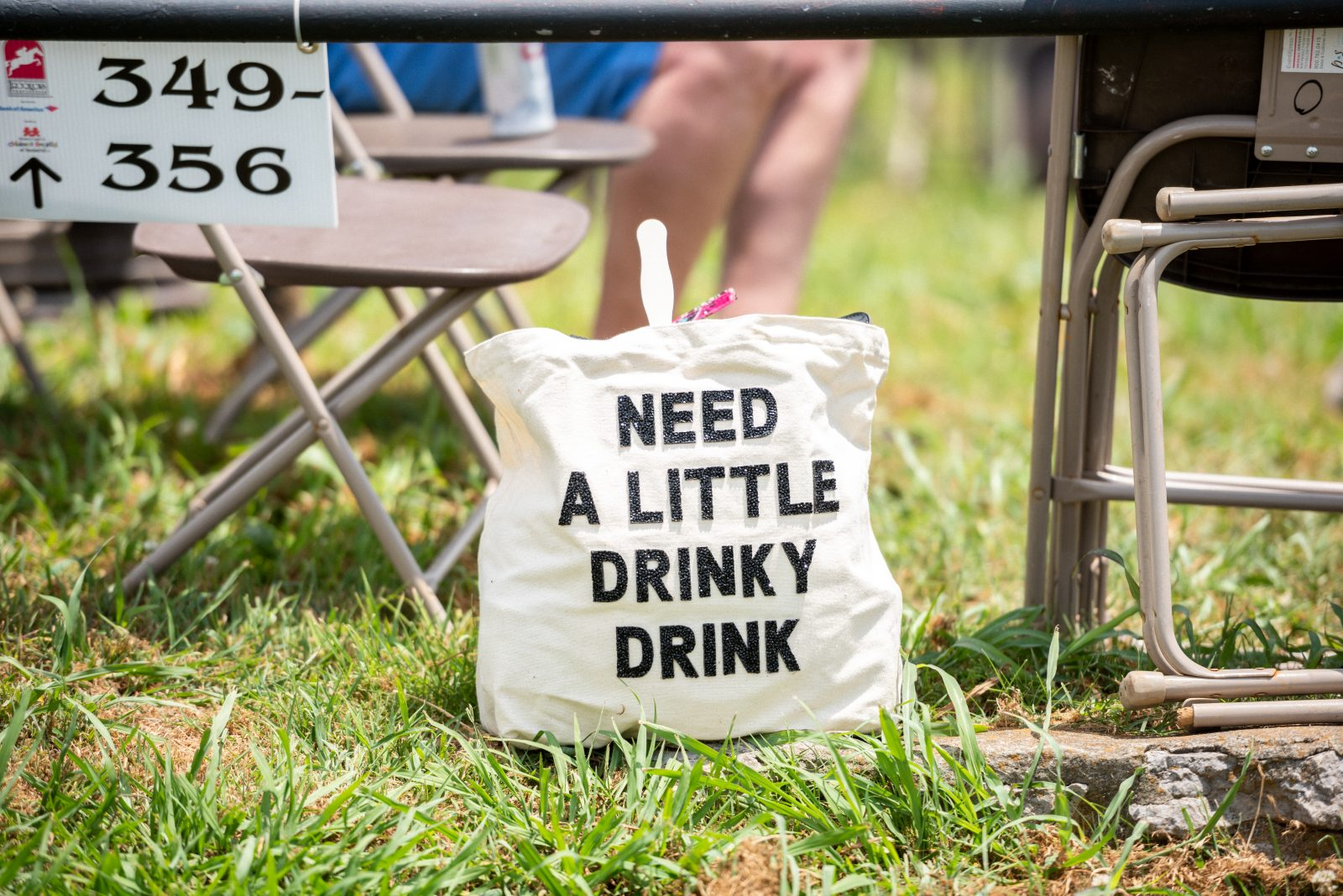"""A handbag with the words: """"need a little drinky drink"""""""