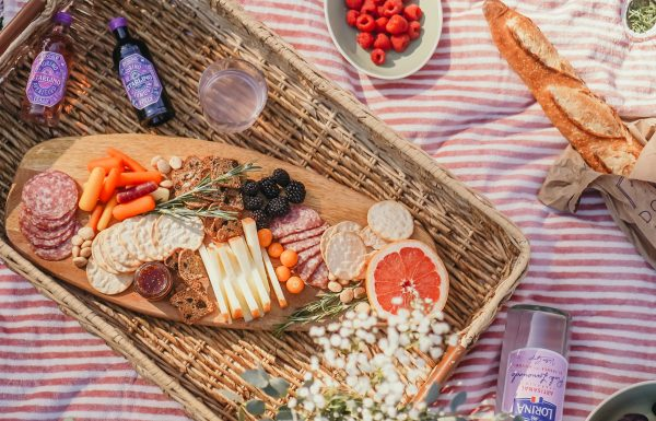 Charcuterie board for a nashville picnic. Served with a baguette and french Lorina.