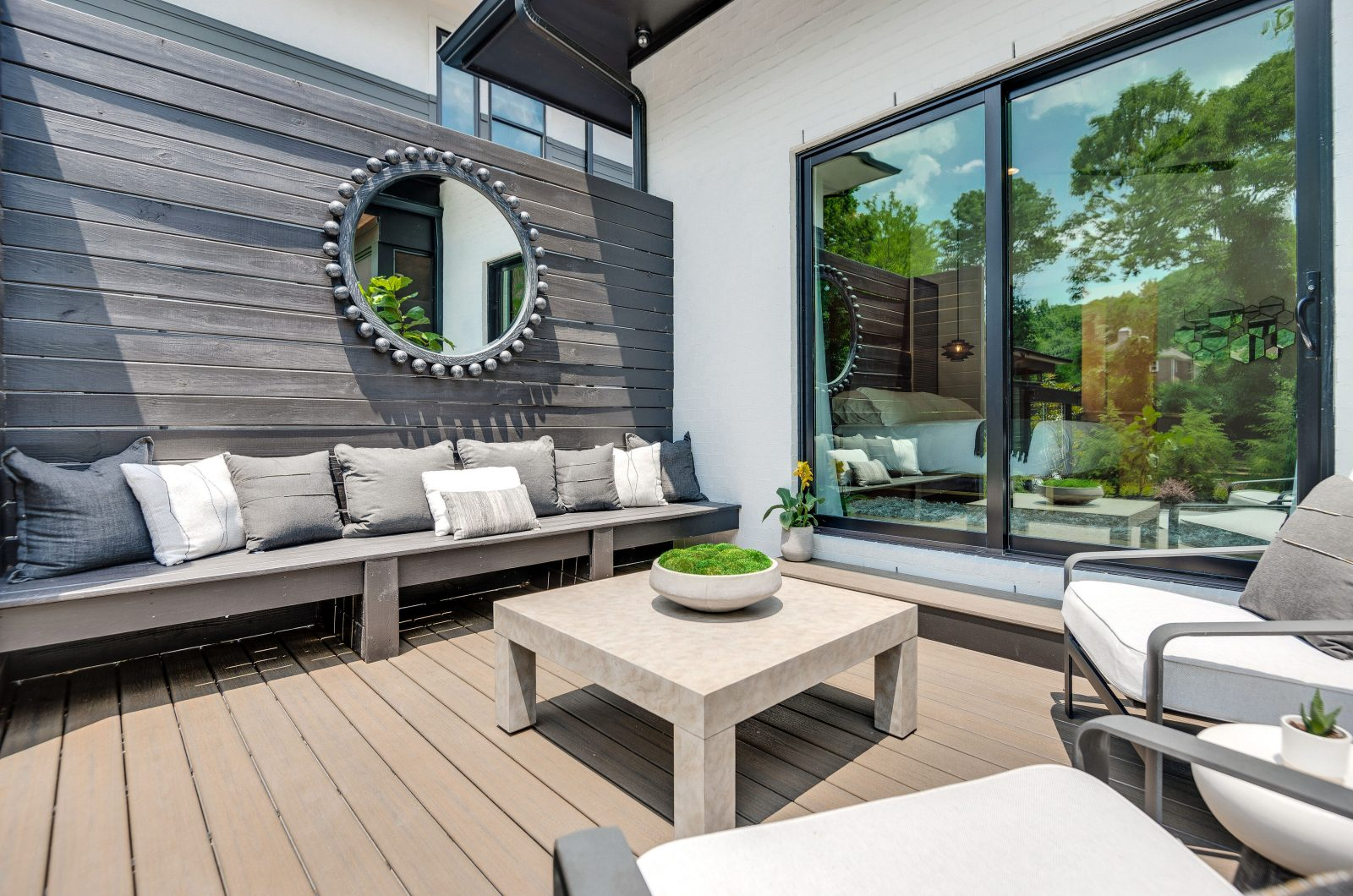 Angle 2 shot of backyard deck and lounge space in Green Hills TN