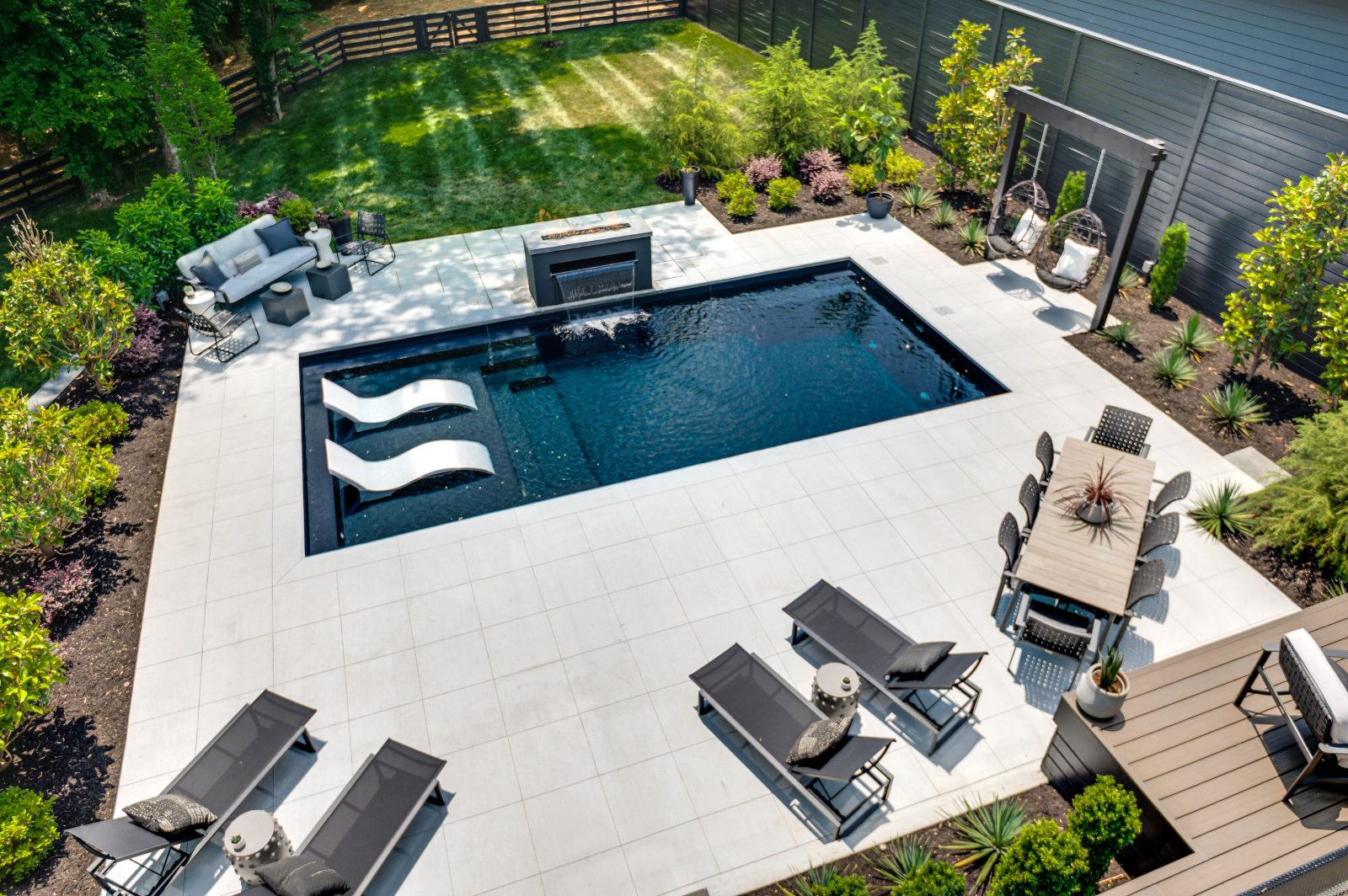 Pool and outdoor entertaining space in Green Hills, TN backyard
