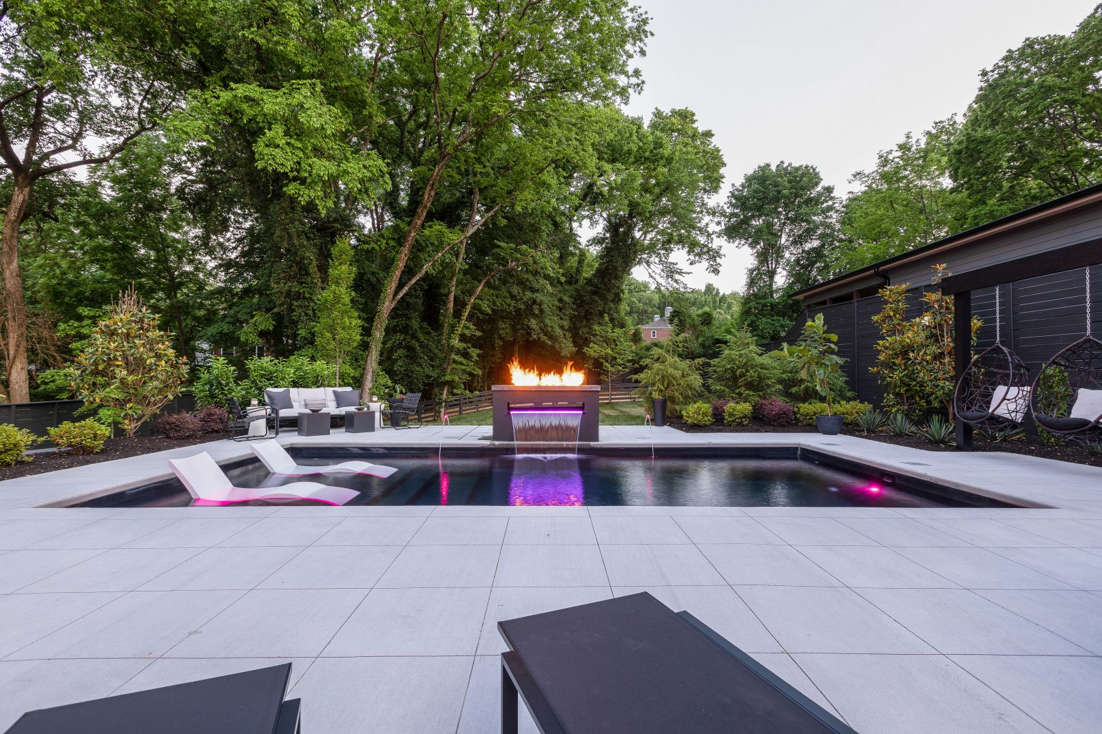 Outdoor backyard pool and fire pit in Green Hills, TN by featured in the Nashville Edit