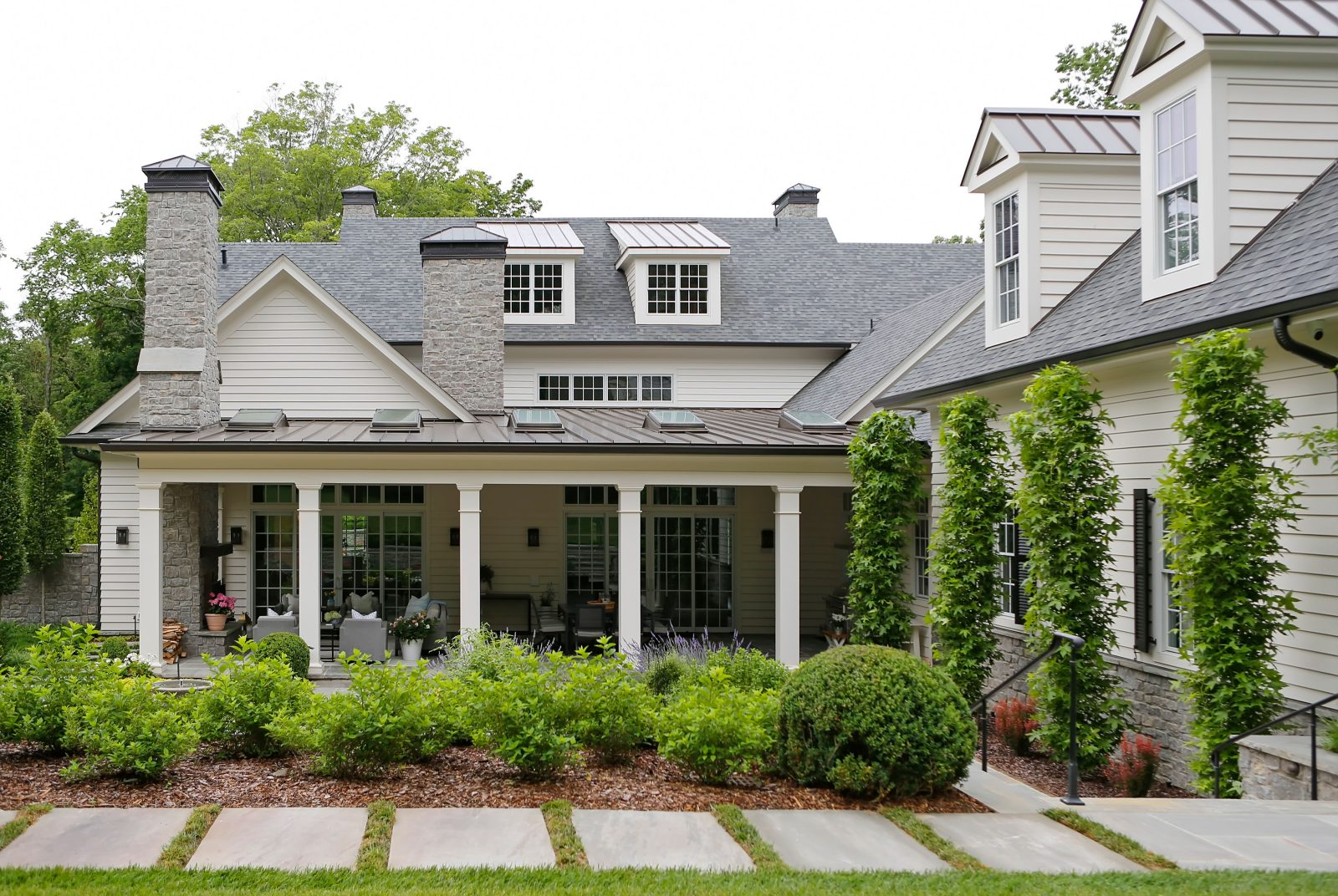 Backyard garden with covered porch with dinning and lounging space