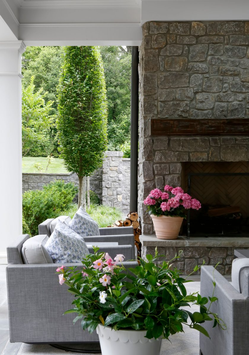 Roofed outdoor lounging space to enjoy this beautiful garden with an outdoor fireplace