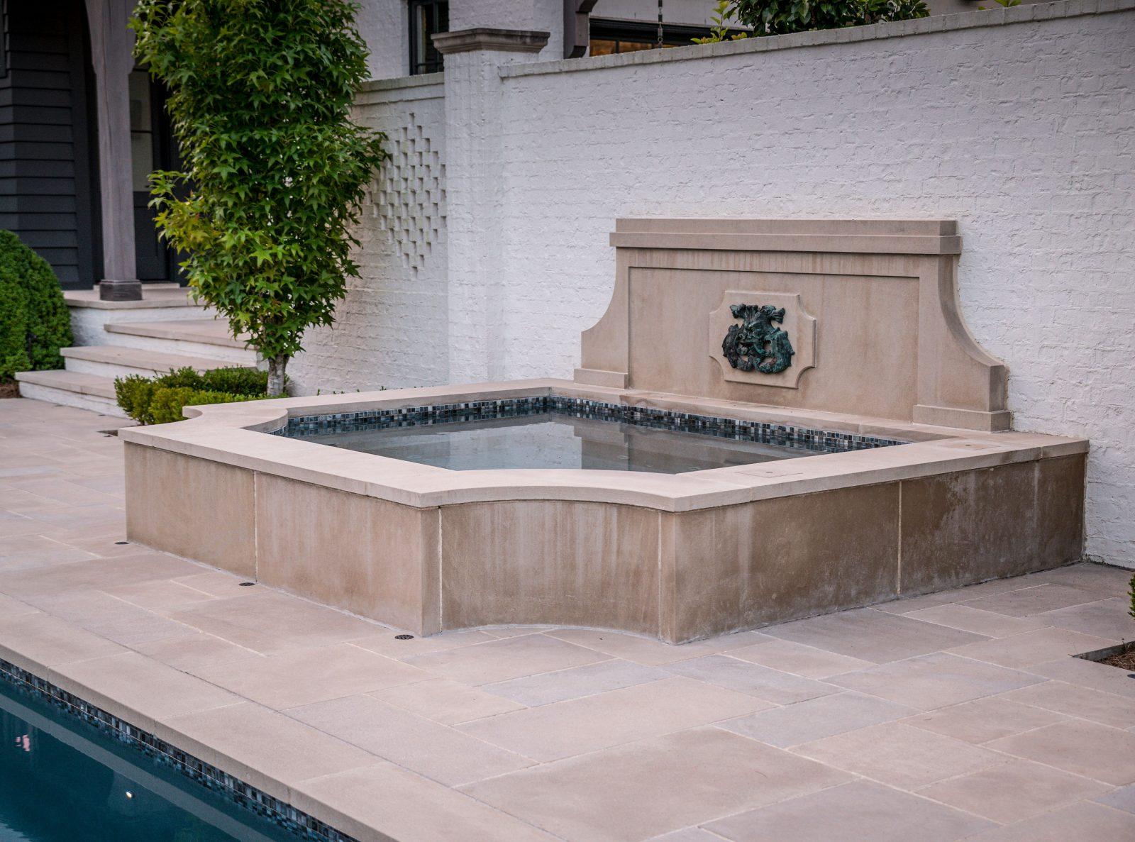 Small hot tub spa in the backyard next to the main backyard pool