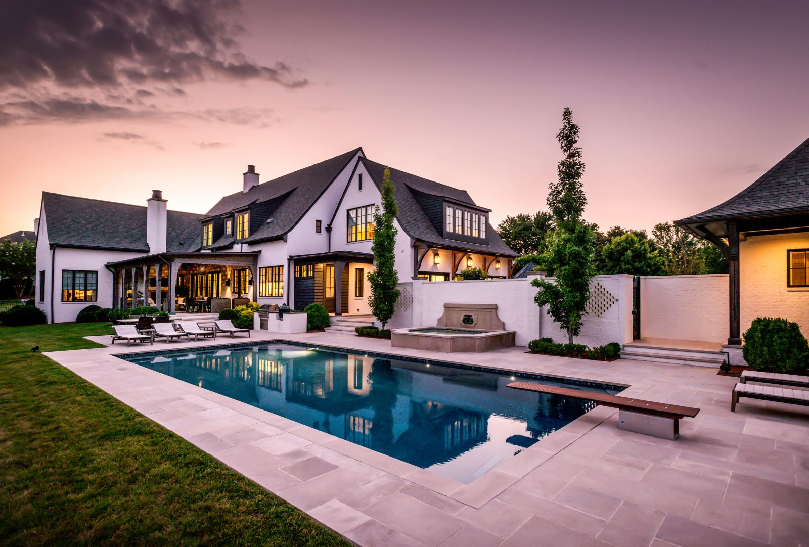 The amazing backyard space built by Castle Homes for Alan and Heather Looney. Backyard pool, Belgian diving board, pool house and more
