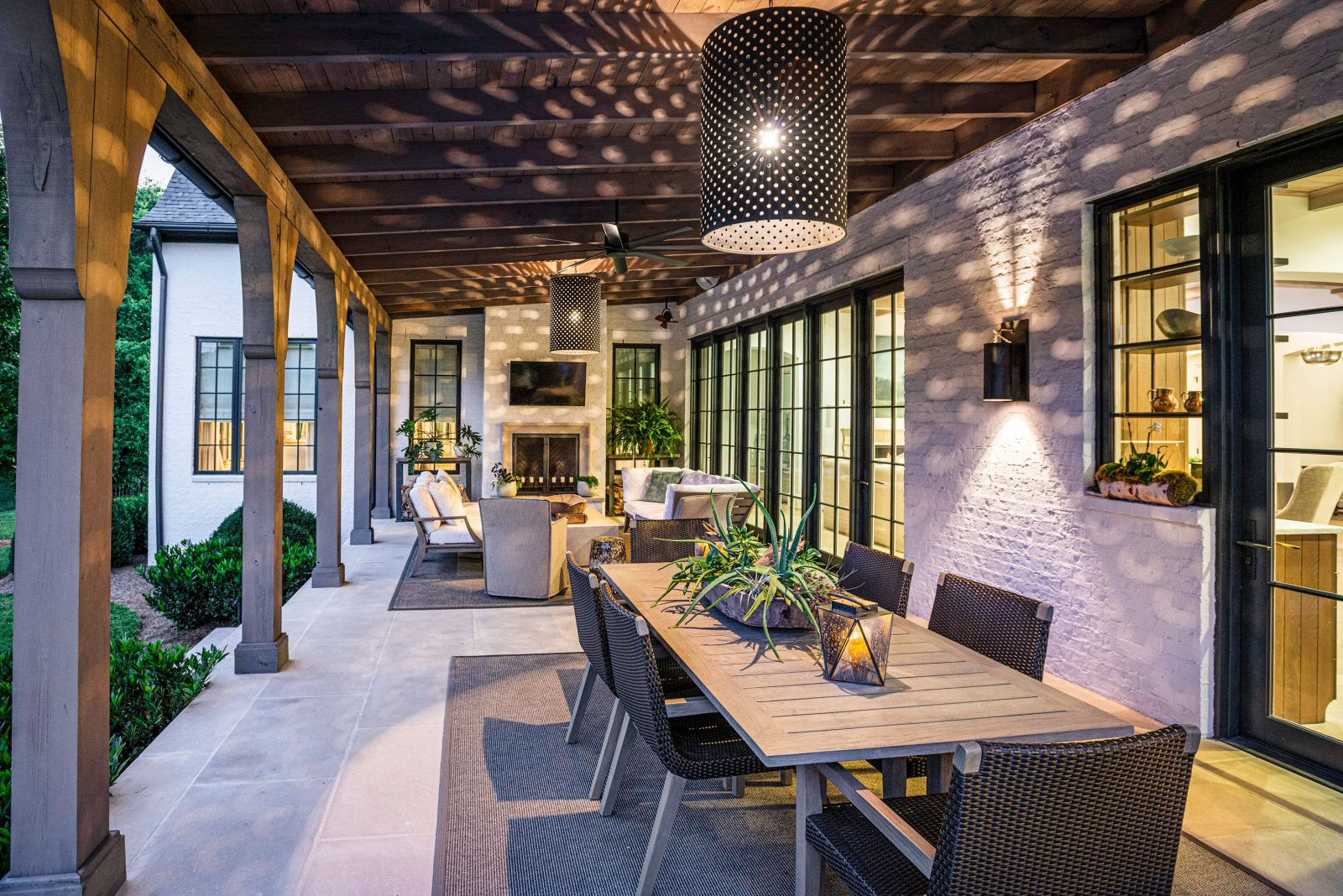 Amazing lighting by Outdoor Lighting Perspectives in this backyard entertainment and dining space