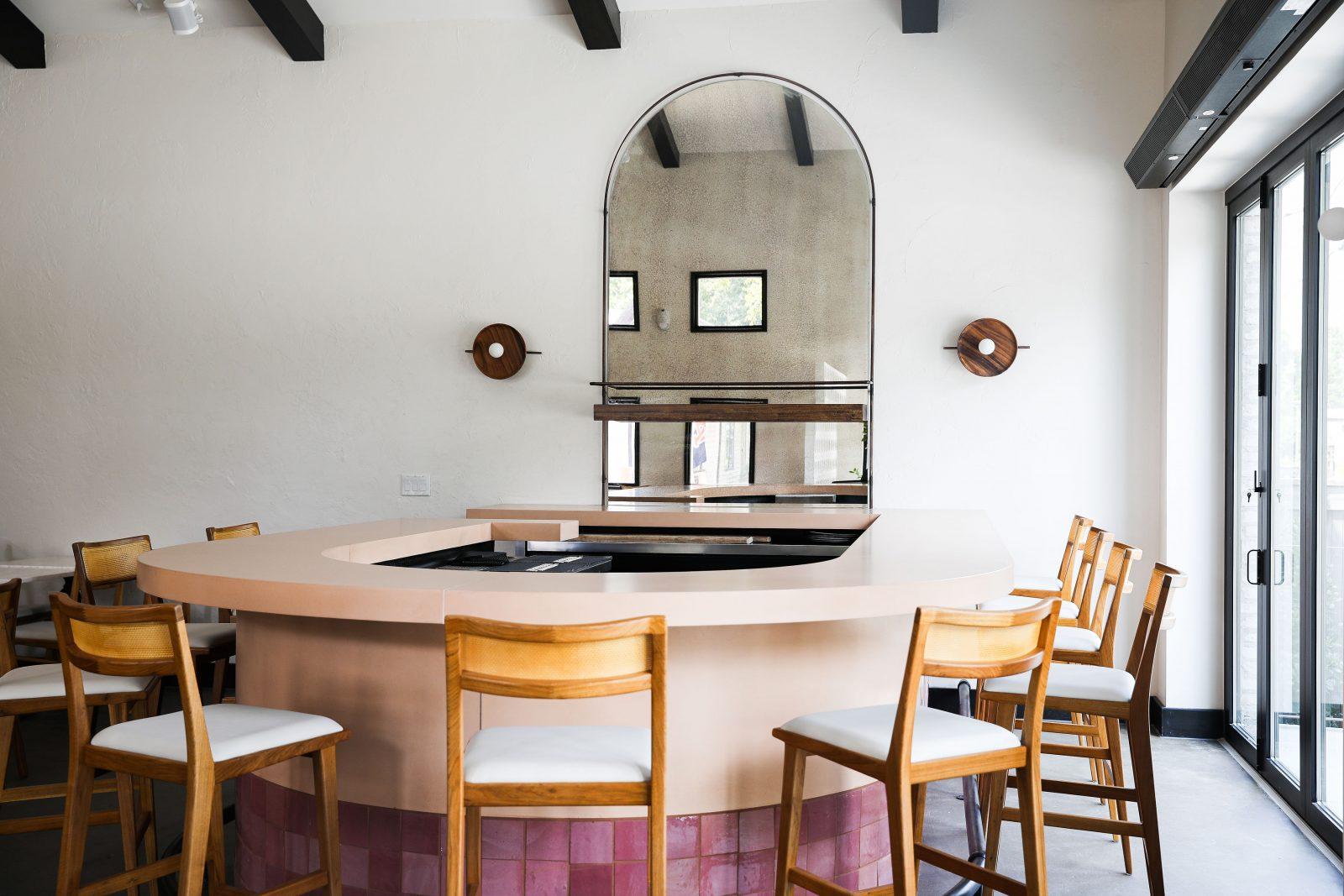 inside Lola Spanish tapas restaurant simple modern elegant bar top pink tile