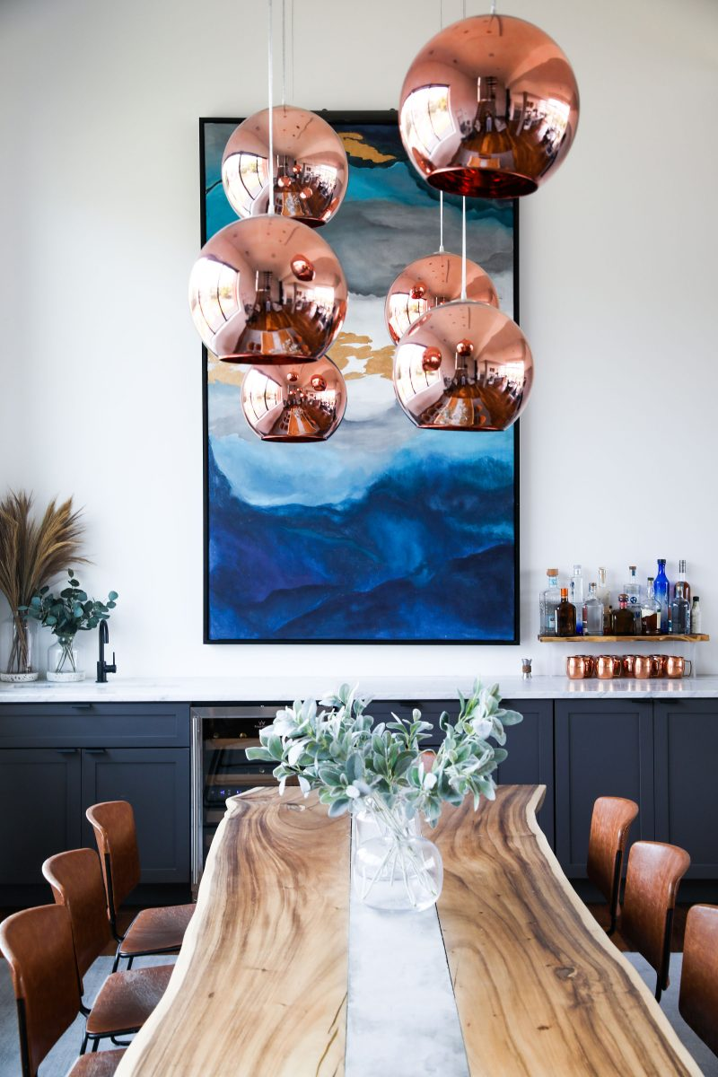 brooke and brice gilliam making modern magnolia network simple modern house wooden dinning room table blue artwork bar in dinning room